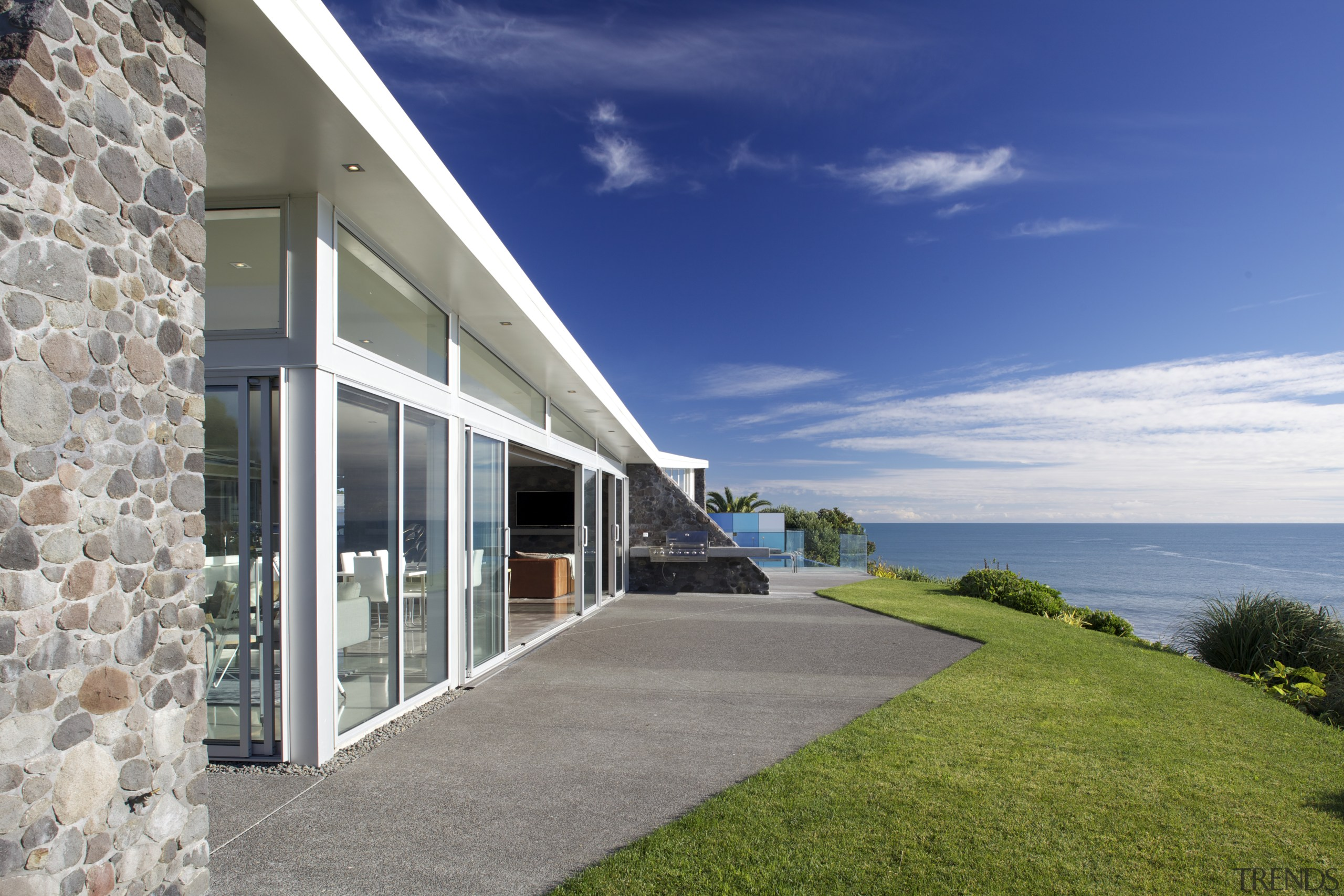 Contemporary cliff-top house by Michael Mansvelt - architecture architecture, building, coastal and oceanic landforms, cottage, design, estate, facade, grass, home, house, interior design, property, real estate, residential area, sea, sky, villa, window, blue, gray