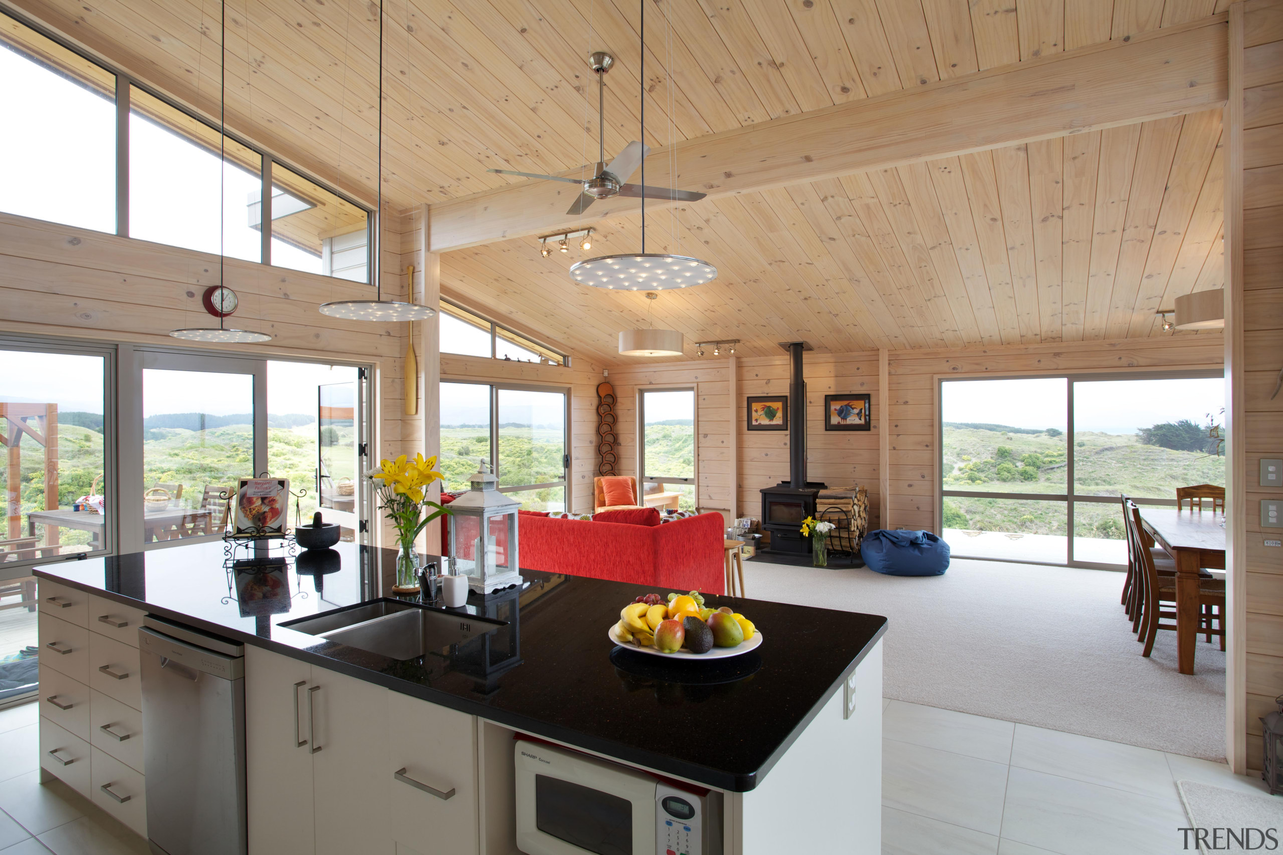 Solid blonded timber walls and ceilings keep this ceiling, countertop, house, interior design, kitchen, real estate, window