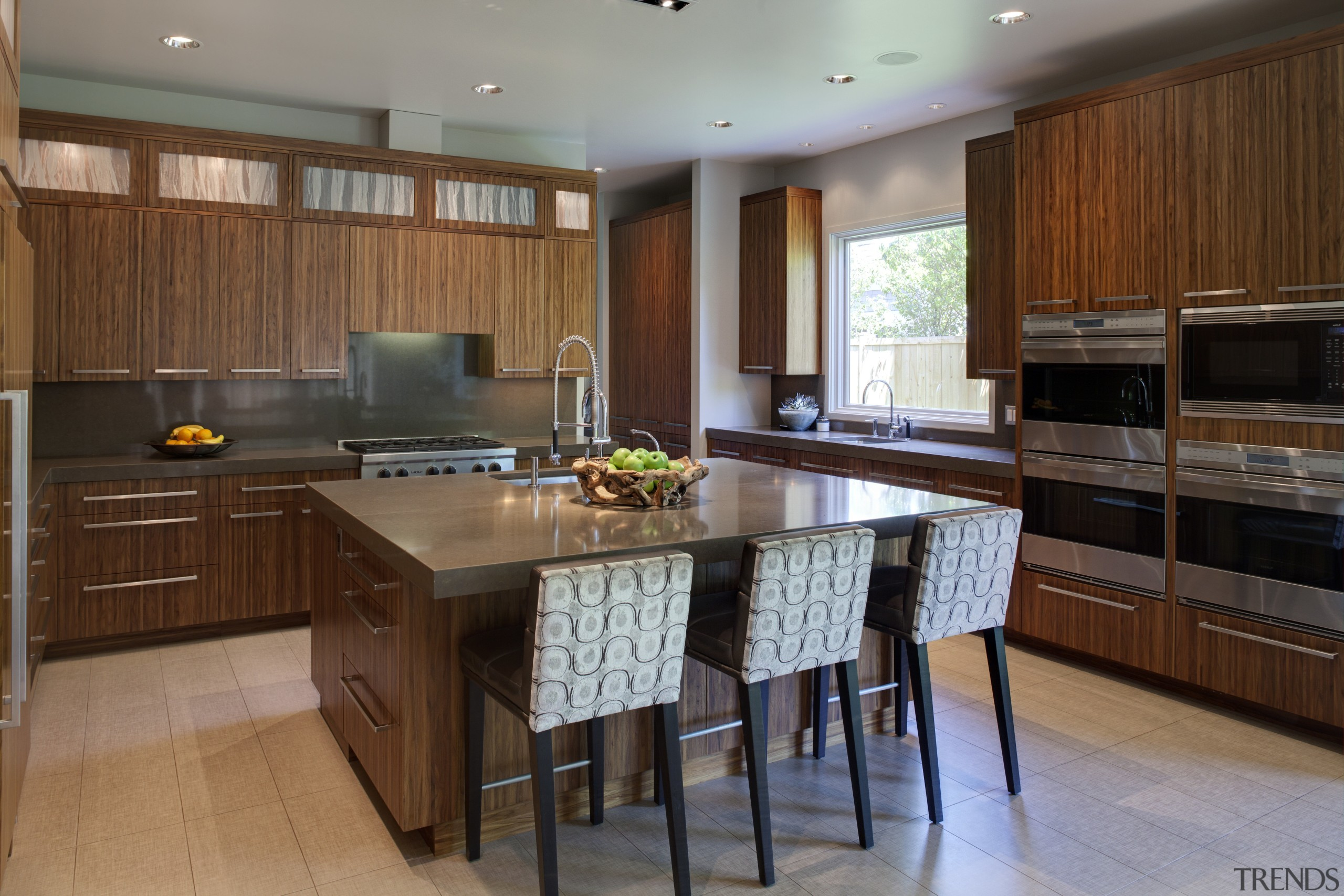 boxy kitchen with island and cabinets in a cabinetry, countertop, cuisine classique, floor, flooring, hardwood, interior design, kitchen, real estate, room, wood flooring, brown, gray