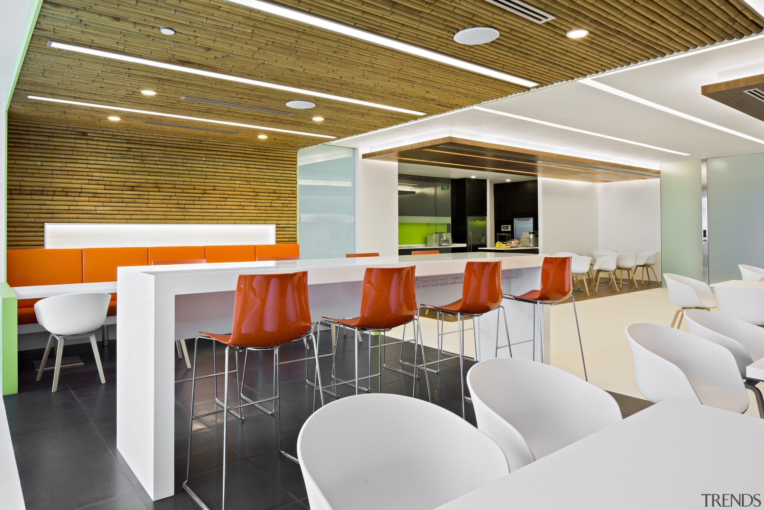 Bright orange and green enliven the staff pantry architecture, cafeteria, ceiling, conference hall, interior design, office, product design, table, white