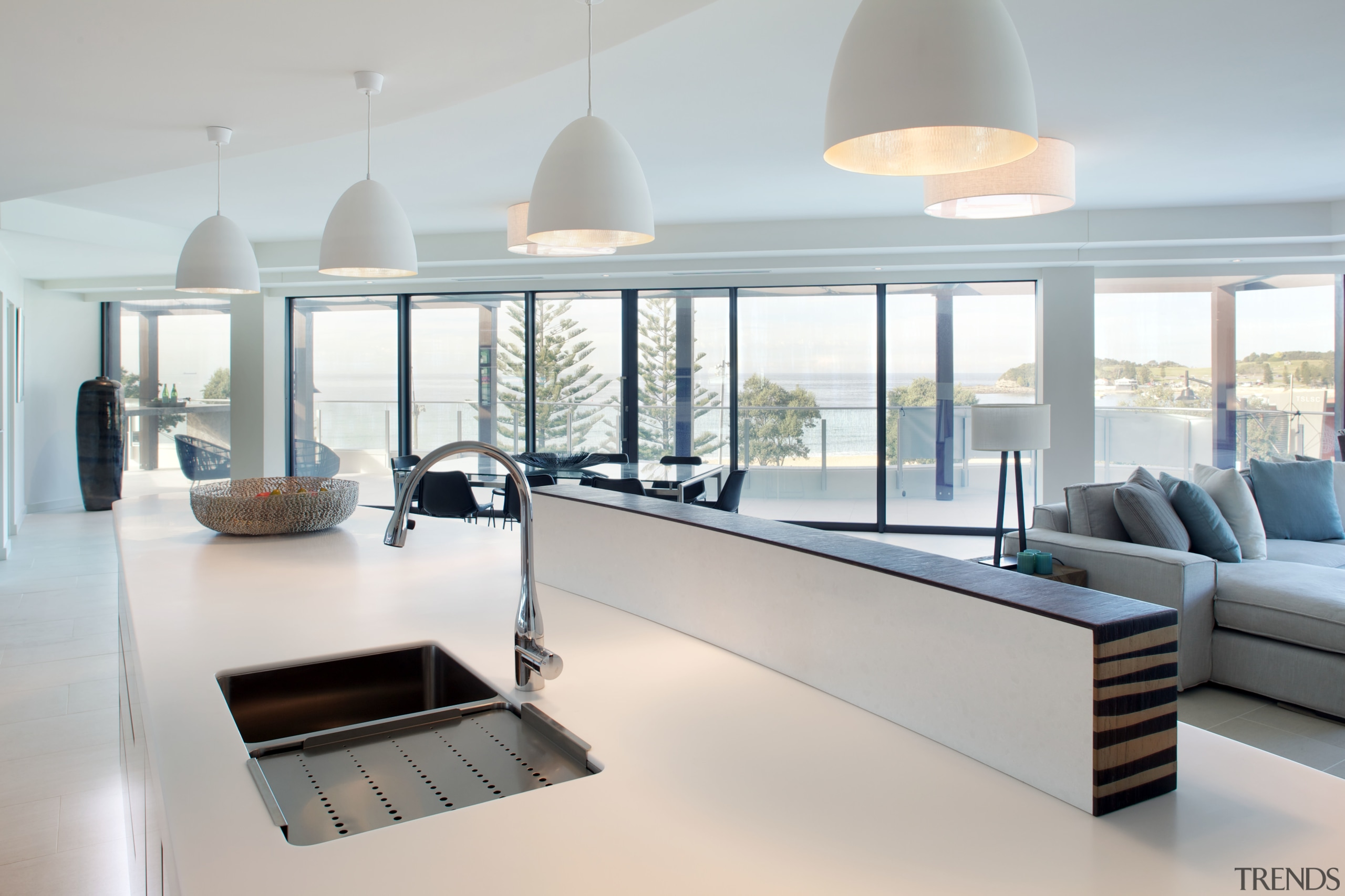 This penthouse open plan kitchen features an upstand furniture, interior design, living room, product design, table, window, gray
