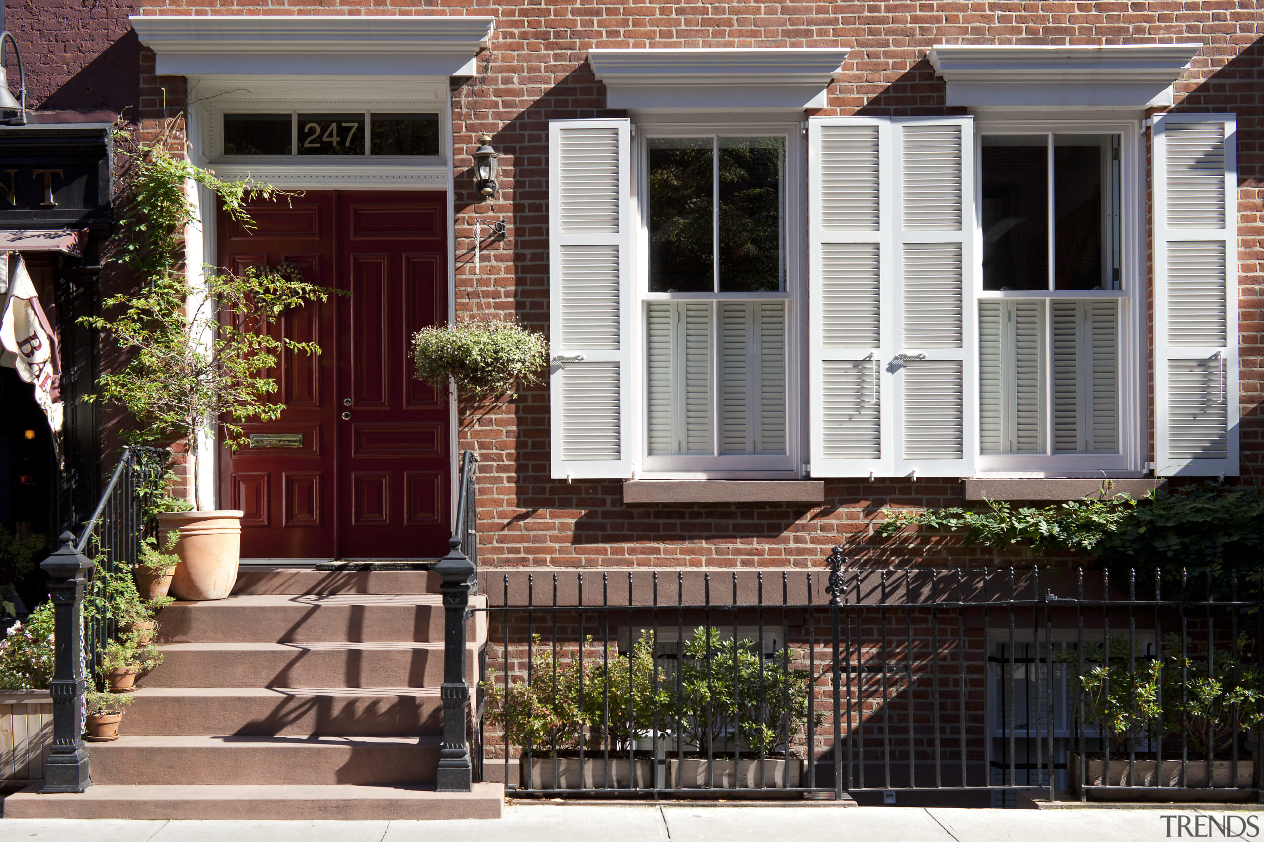 Front entry to remodeled Manhattan townhouse - Front backyard, door, facade, home, house, landscaping, neighbourhood, outdoor structure, porch, property, real estate, residential area, siding, walkway, window, yard, black