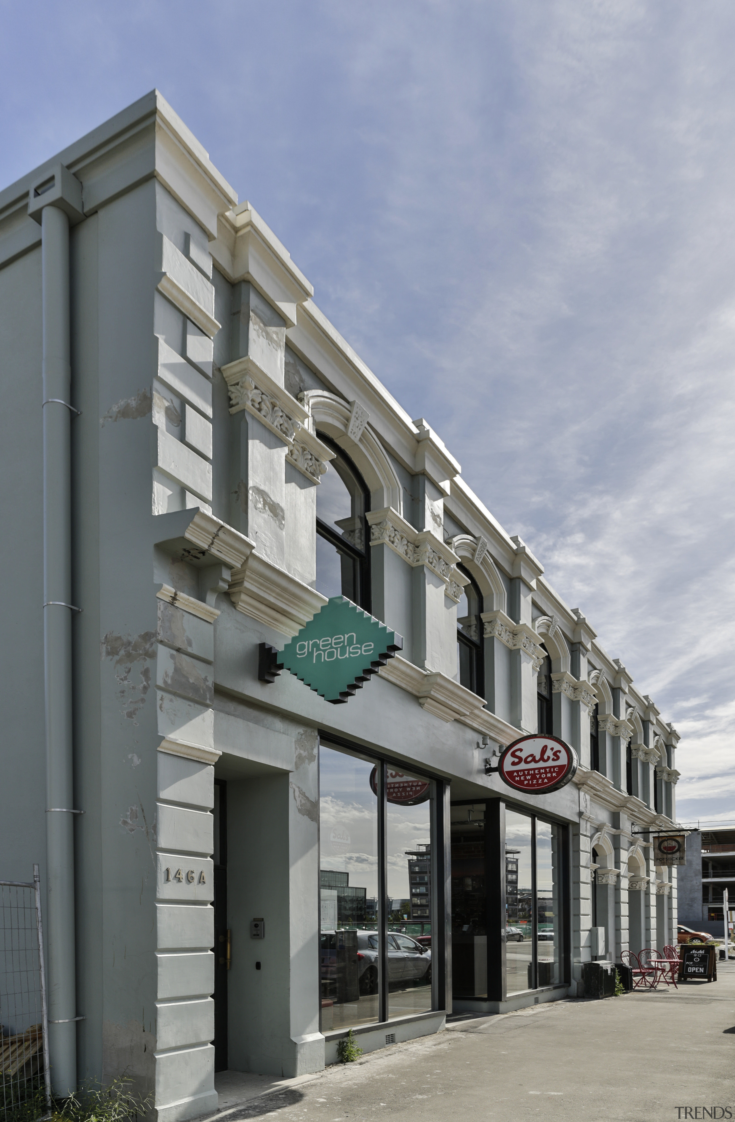 Following the Christchurch earthquakes, an internal structural frame apartment, architecture, building, commercial building, condominium, facade, house, mixed use, neighbourhood, real estate, residential area, gray