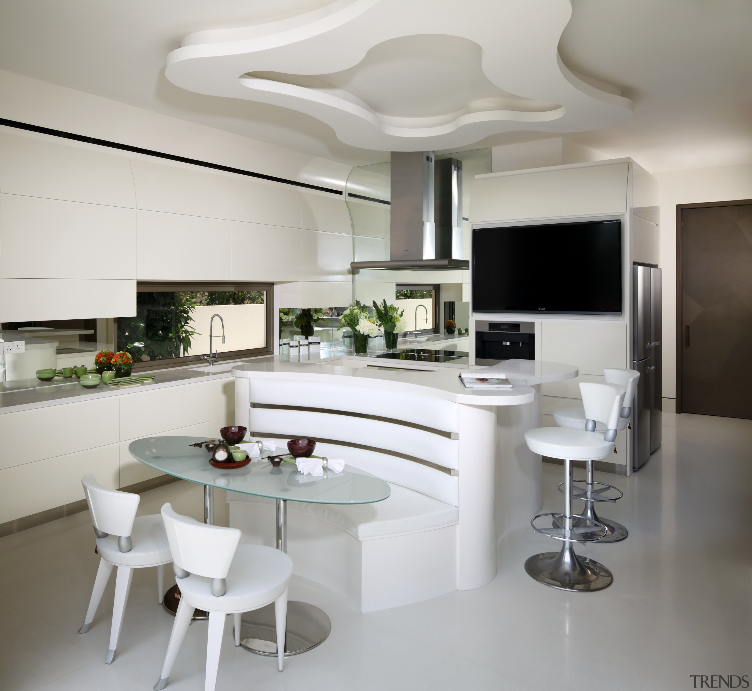 This dry kitchen in an individualistic Singaporean home countertop, furniture, interior design, interior designer, kitchen, living room, product design, table, gray