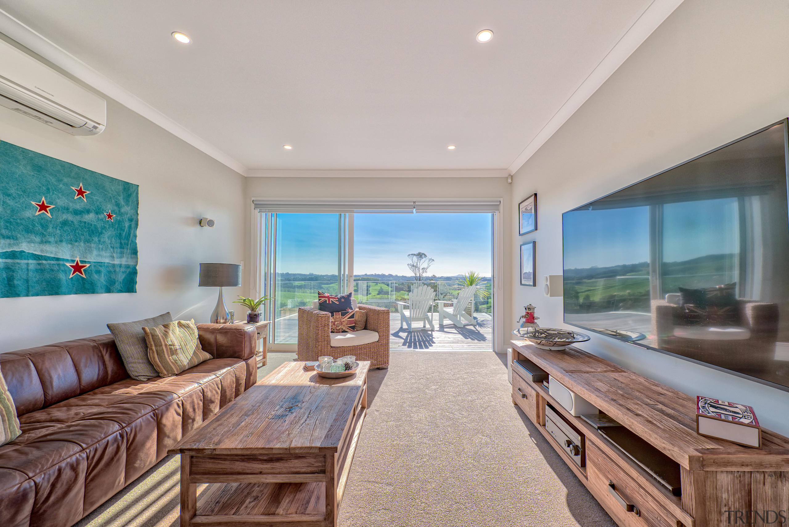 Indoor-outdoor flow is a feature of most rooms ceiling, estate, home, interior design, living room, property, real estate, window, fowler homes,  south auckland,  home builder,  resene