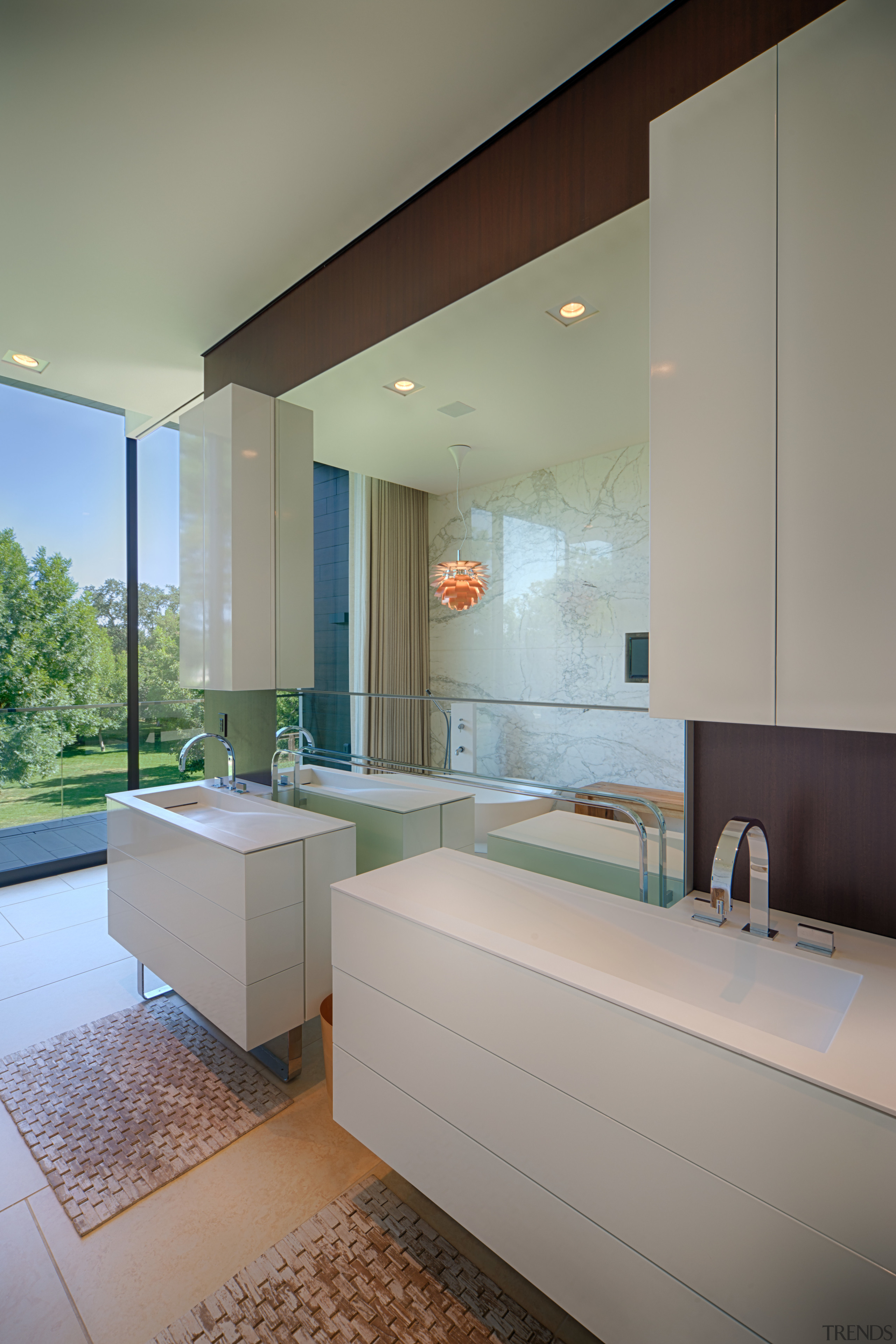 Wading basins are integrated into the vanities on architecture, bathroom, ceiling, home, interior design, real estate, room, sink, gray