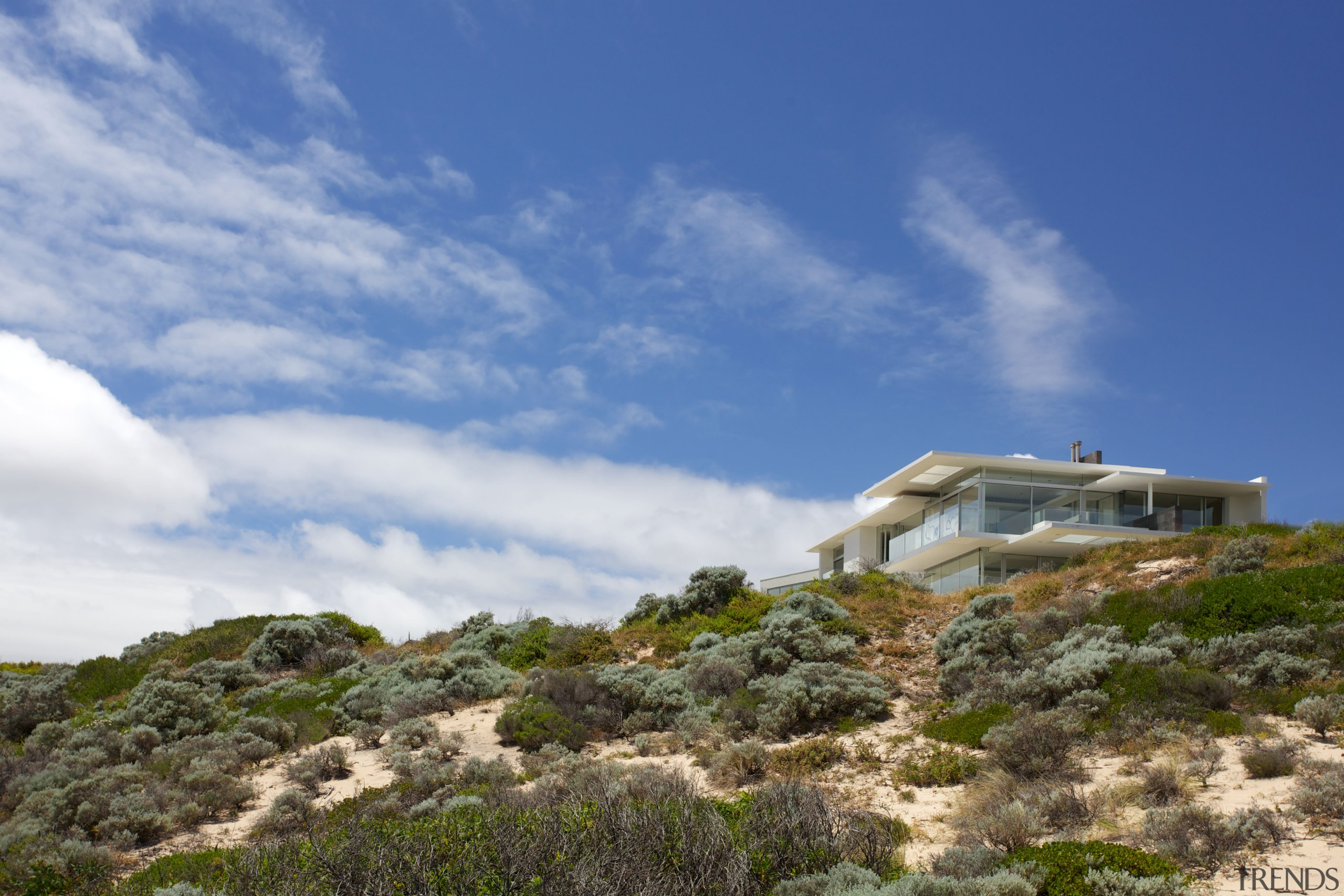 While the oceanside site provides a great outlook, cloud, coast, hill, house, mountain, plant community, real estate, shrubland, sky, terrain, blue