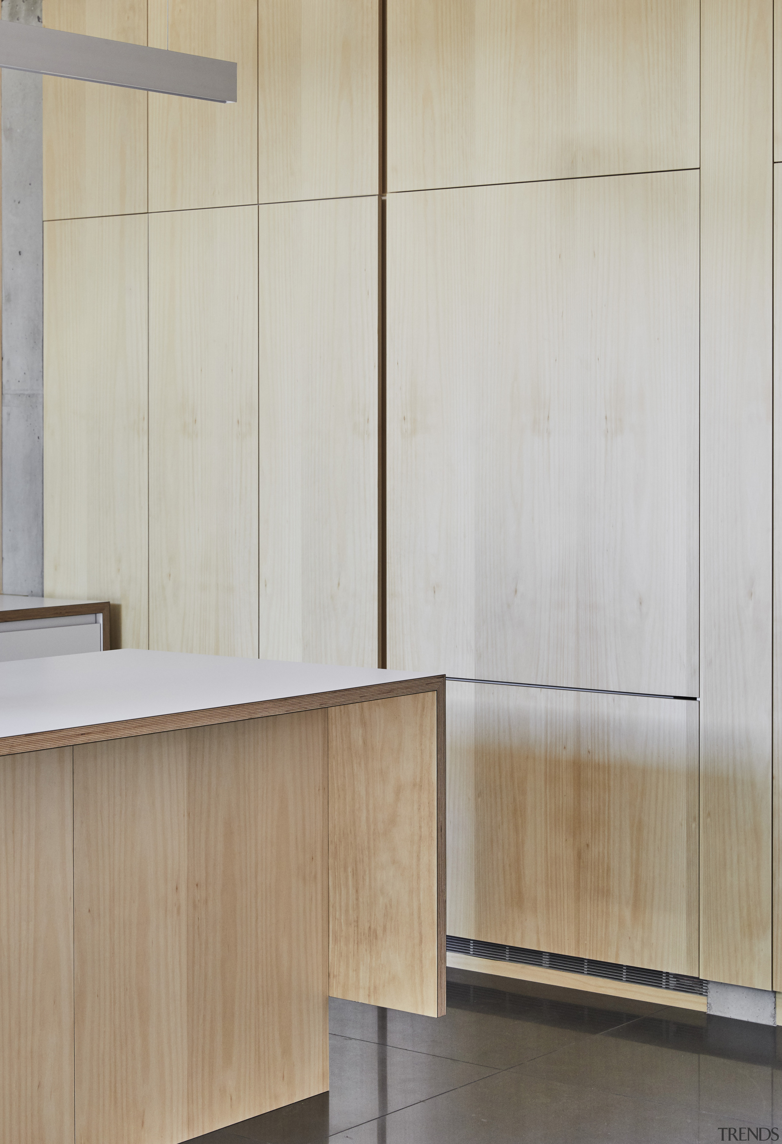 This kitchen's hoop pine veneer cabinetry is repeated architecture, cabinetry, cupboard, floor, flooring, furniture, interior design, material property, plywood, property, room, wall, wood, wood stain, gray