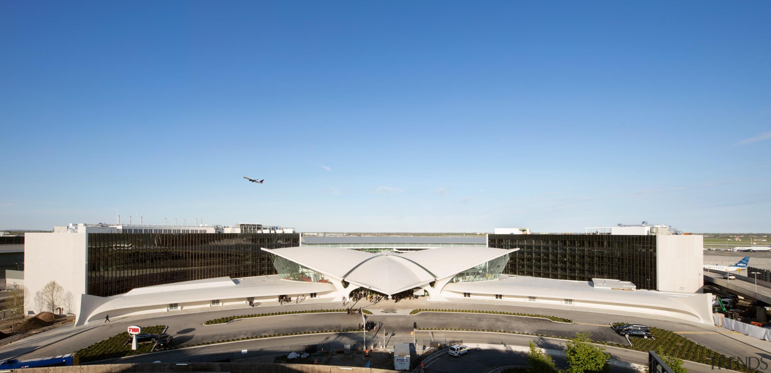 Two brand new wings behind Eero Saarinen's historic aerospace engineering, air travel, aircraft, airline, airliner, airplane, airport, airport apron, TWA Hotel