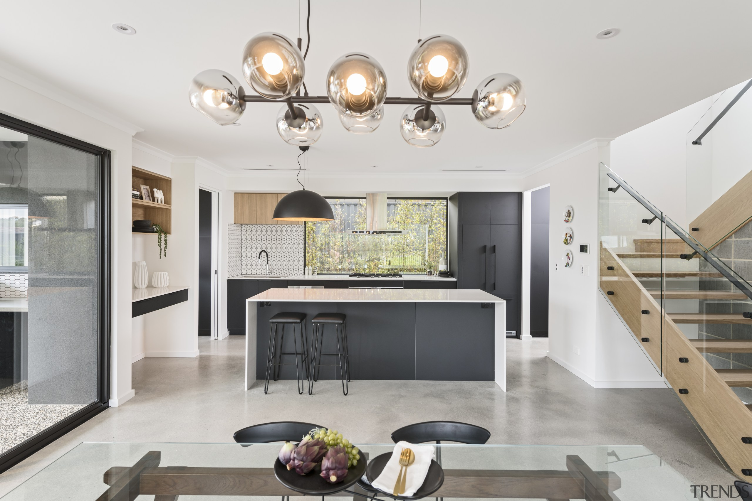 The industrial feel is matched with the polished apartment, architecture, building, cabinetry, ceiling, design, dining room, floor, flooring, furniture, home, house, interior design, light fixture, lighting, living room, loft, property, real estate, room, stairs, table, tile, wall, yellow, white, gray