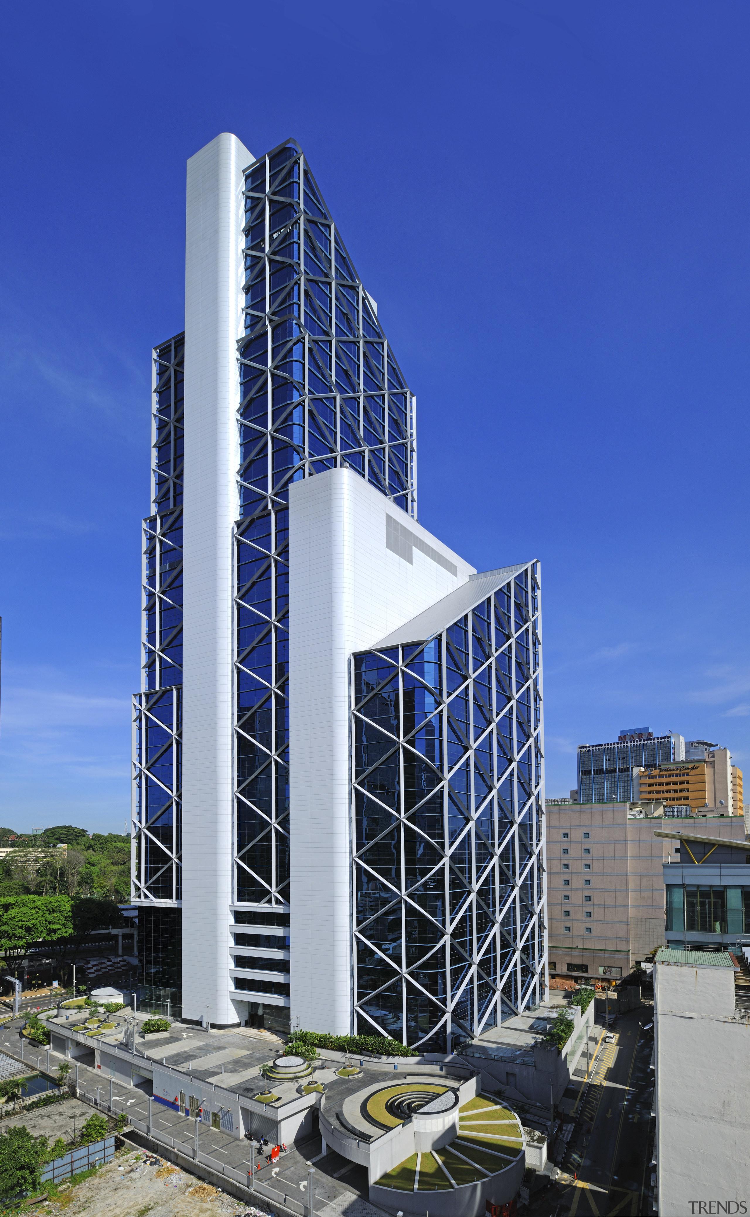 The new Menara Bumiputra Commerce tower is appropriate architecture, building, commercial building, condominium, corporate headquarters, daytime, facade, headquarters, metropolitan area, mixed use, sky, skyscraper, tower block, blue