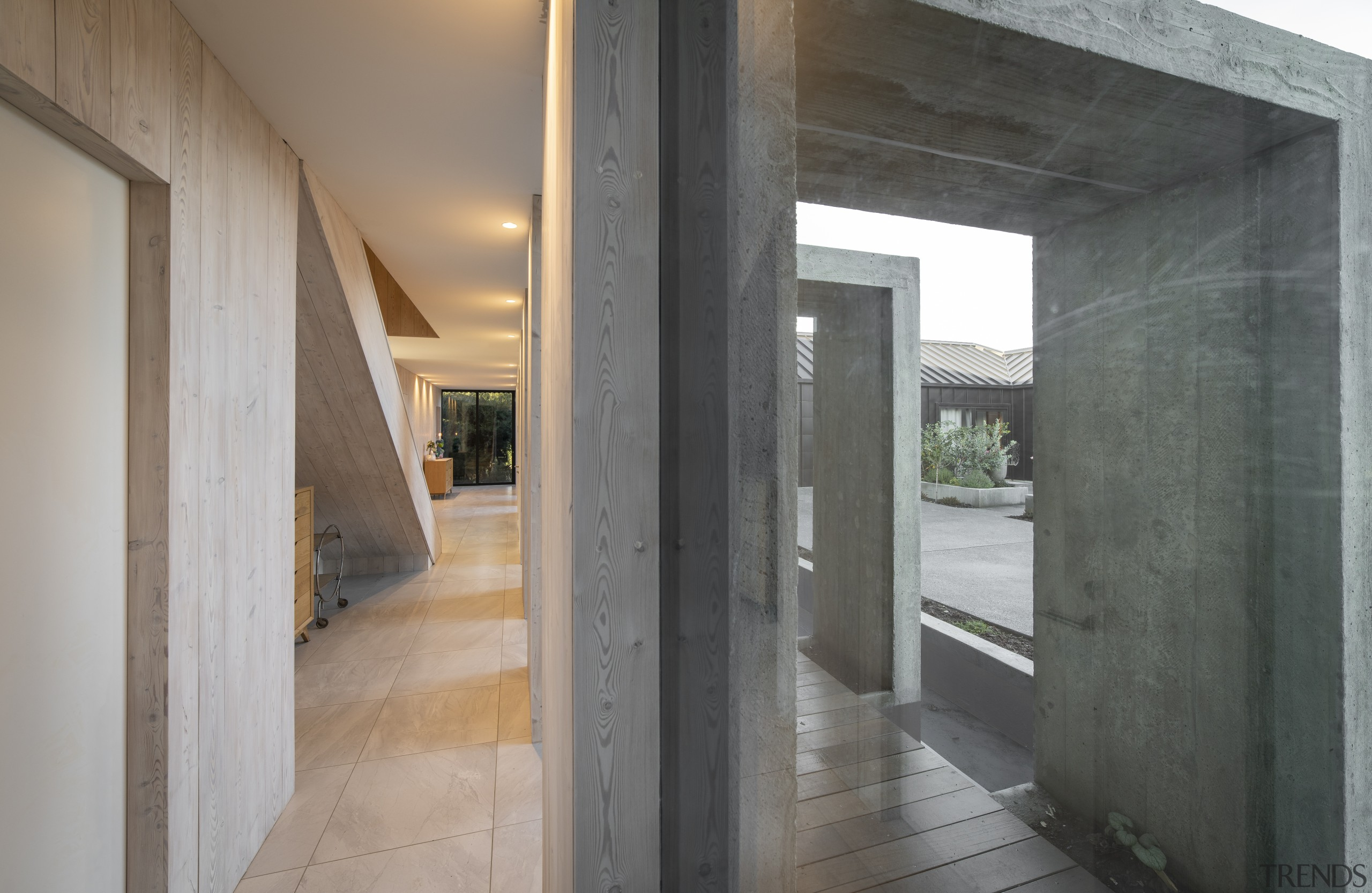 The sculptural external walkway entry to this home gray