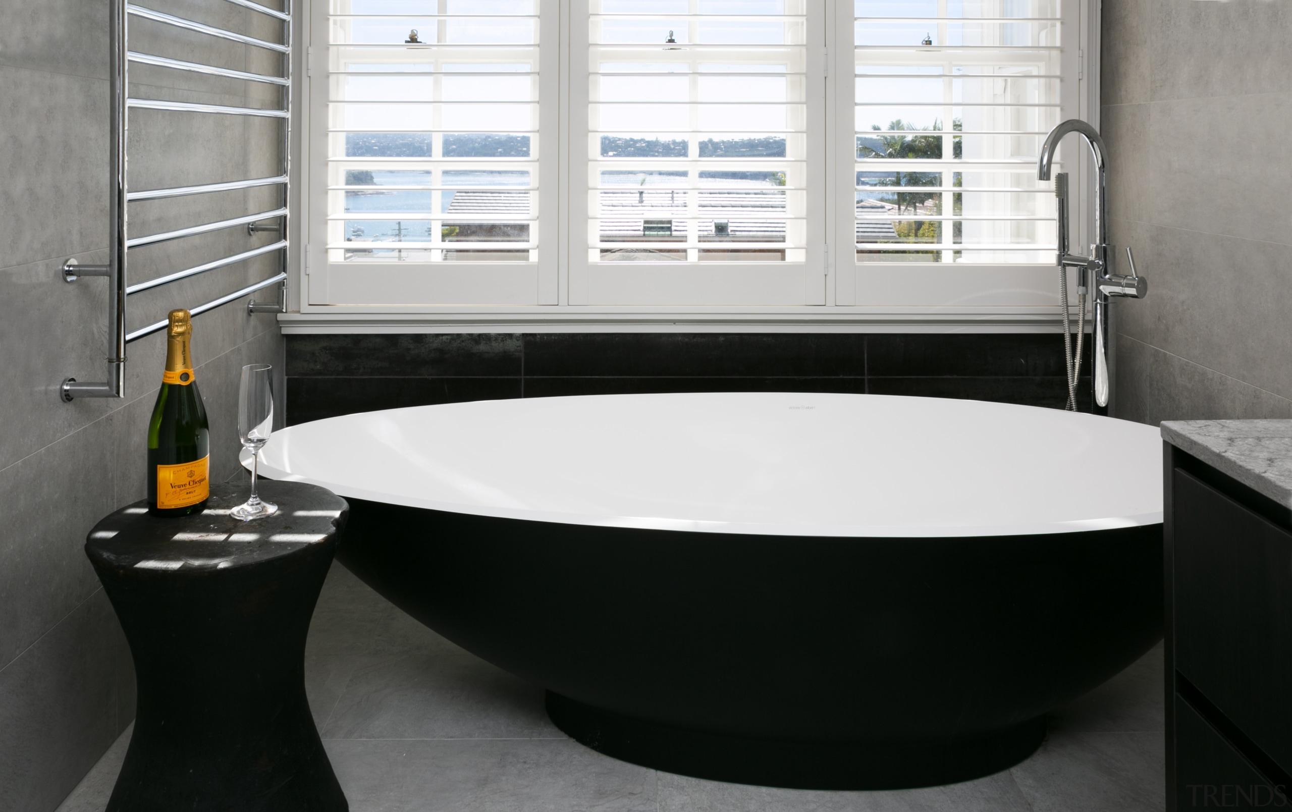 Pride of place – for this master ensuite architecture, bathroom, bathroom sink, bathtub, black, floor, flooring, home, interior design, jacuzzi, material property, plumbing fixture, property, room, sink, tap, tile, black, white