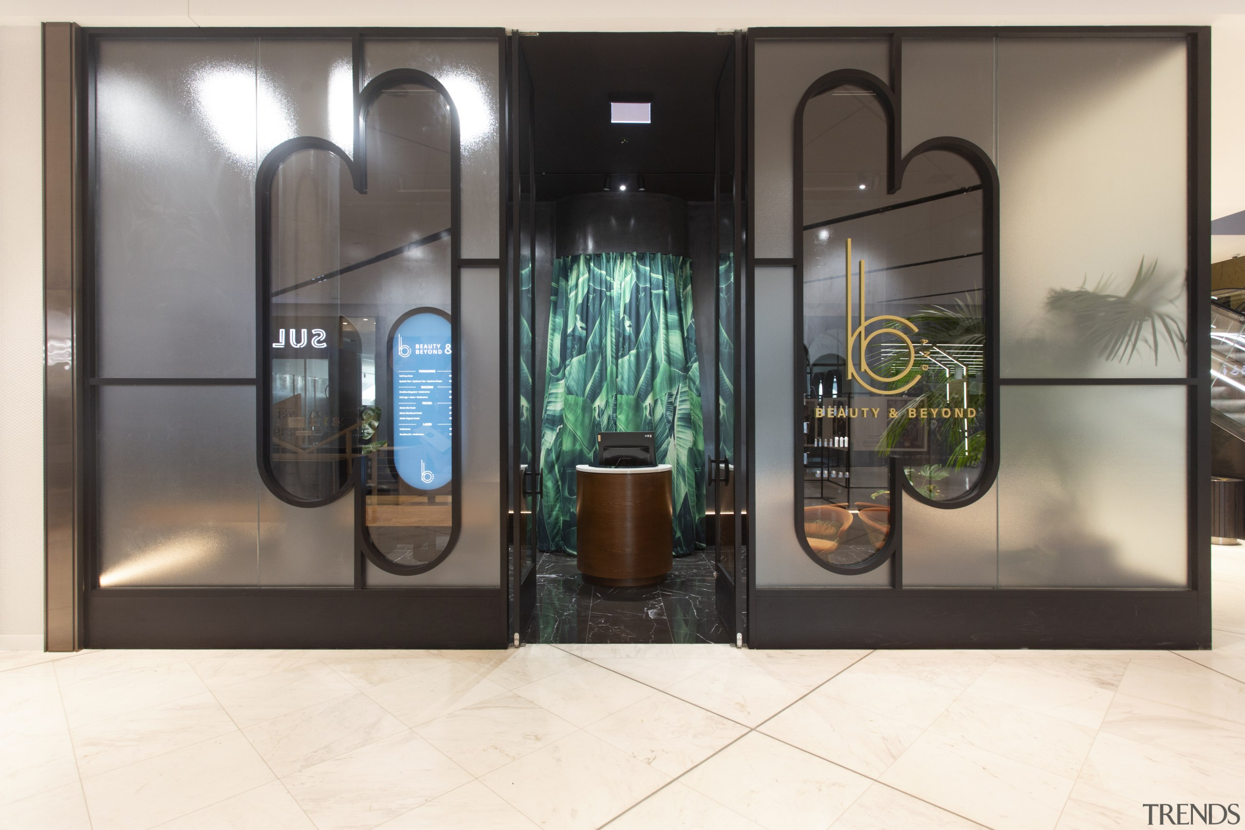 The fit-out emanates a sense of drama before door, furniture, glass, interior design, iron, metal, room, white, black, gray