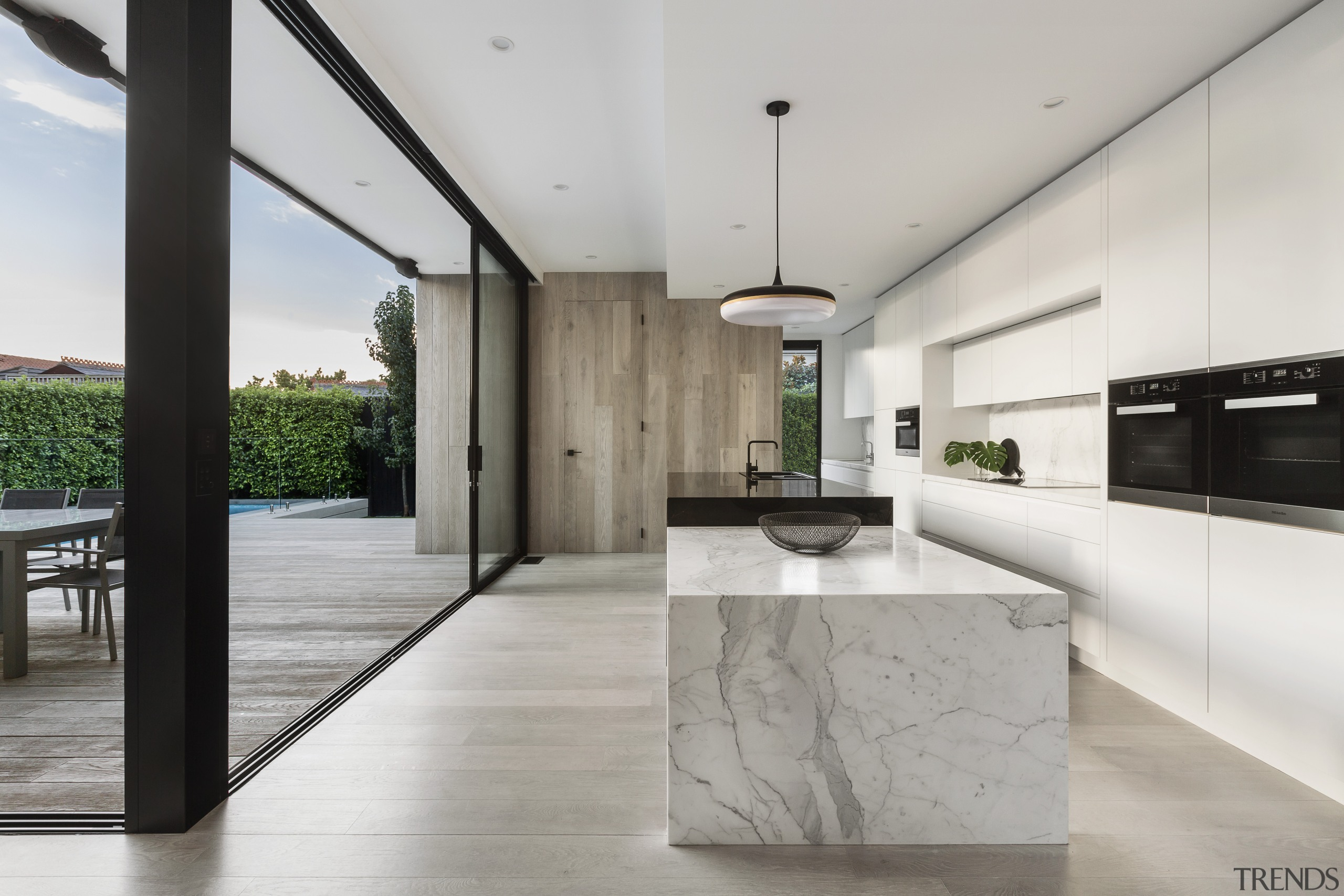 ​​​​​​​On this renovation by LSA Architects, the wood-clad architecture, countertop, benchtop, floor, house, interior design, kitchen, timber, marble, LSA Architects
