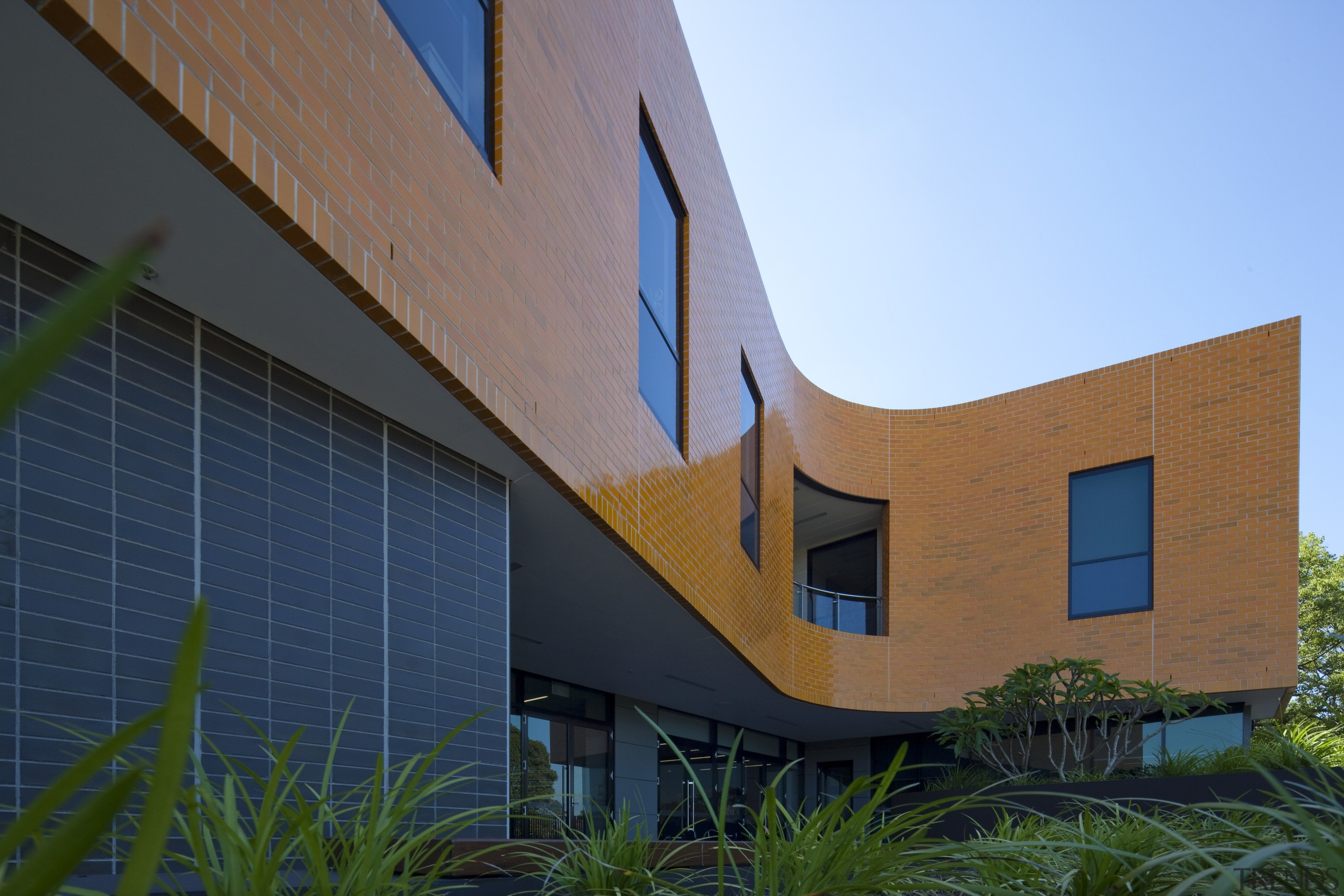 Exterior view of the Poche Centre which was architecture, building, corporate headquarters, elevation, facade, home, house, real estate, residential area, sky