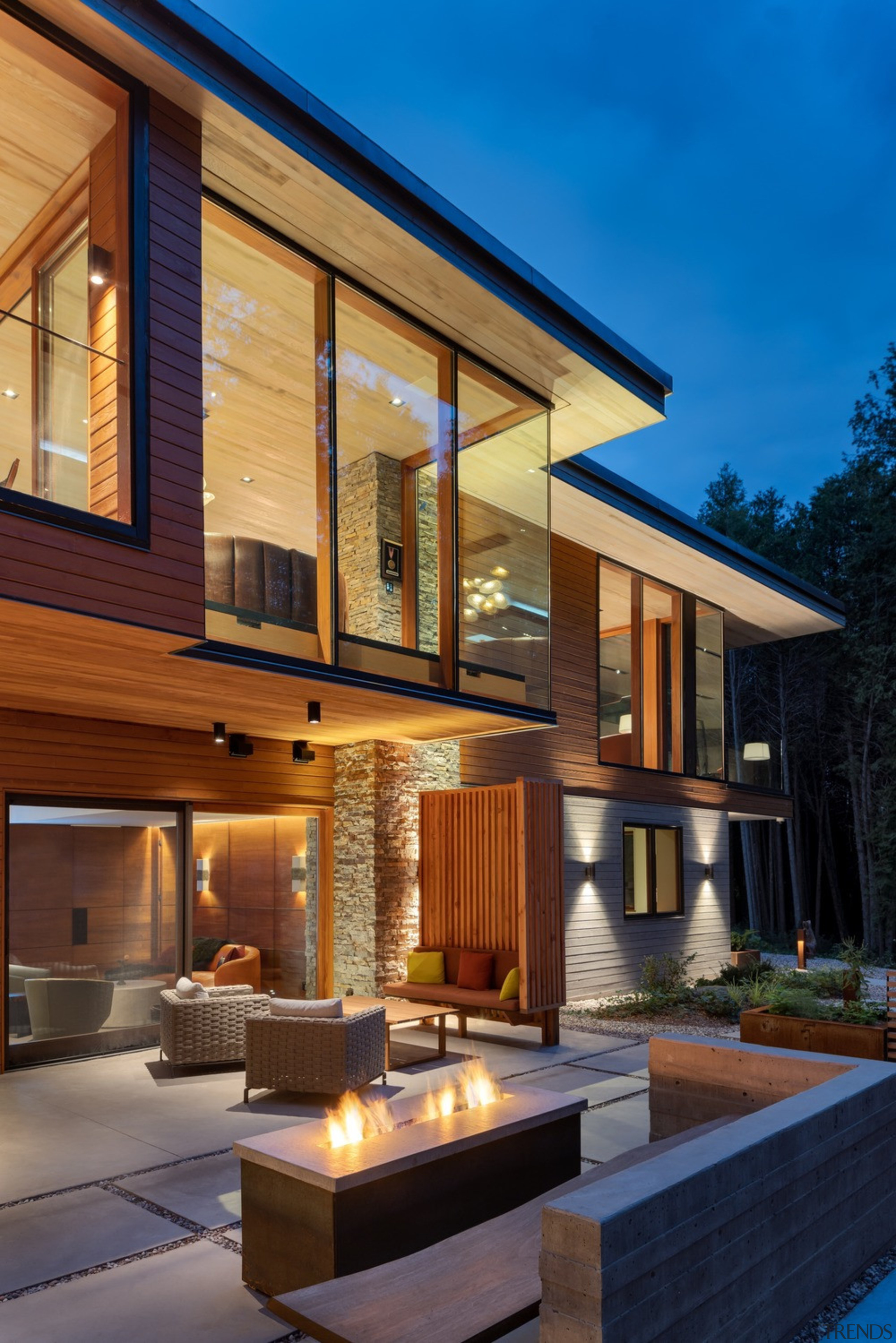 Evening view of house and terrace from the architecture, backyard, building, courtyard, design, estate, facade, furniture, home, house, interior design, lighting, patio, property, real estate, residential area, roof, room, siding, sky, window