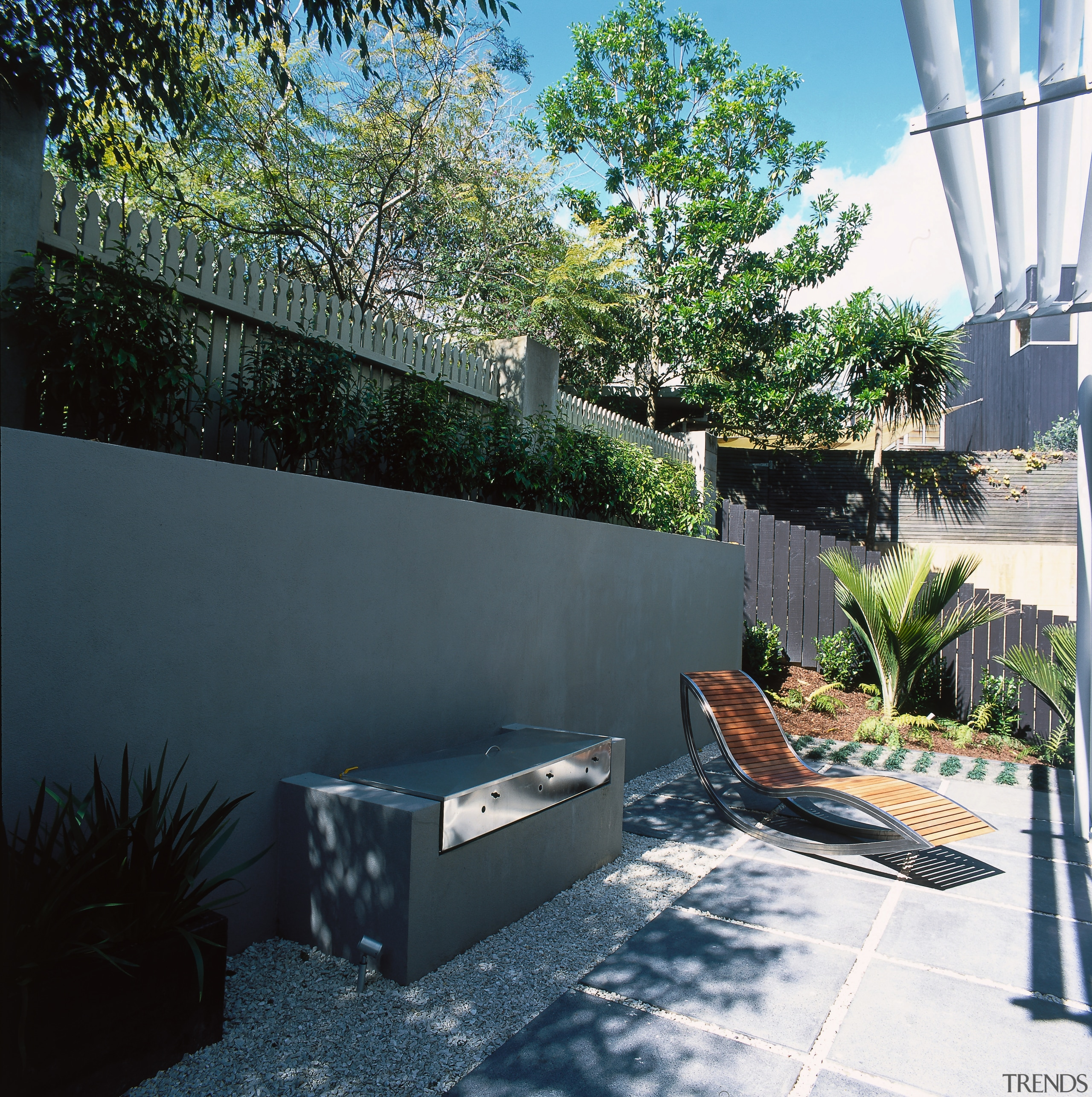 View of the outdoor living space - View architecture, backyard, courtyard, estate, home, house, landscaping, outdoor structure, plant, property, real estate, residential area, roof, tree, wall, yard, black