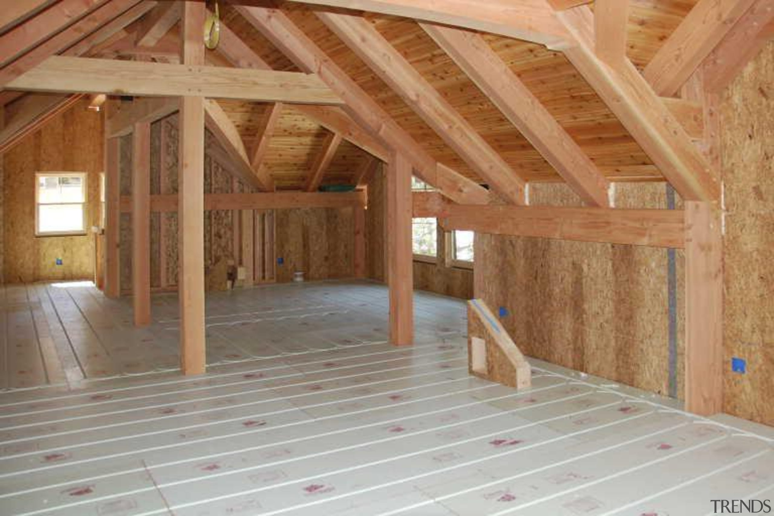 This home looks the part in a winter attic, beam, daylighting, floor, flooring, home, log cabin, lumber, property, real estate, roof, structure, wall, wood, wood flooring, wood stain, brown, gray