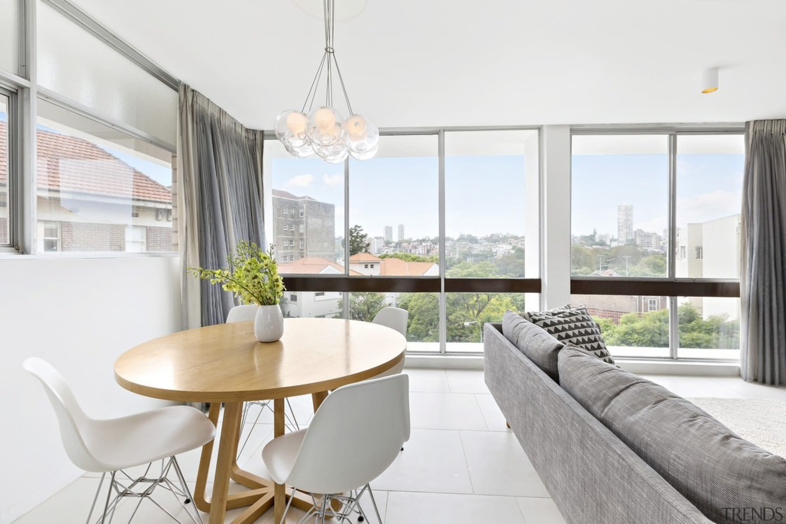 Views out to a sea of gree - apartment, architecture, dining room, home, house, interior design, living room, property, real estate, table, window, white
