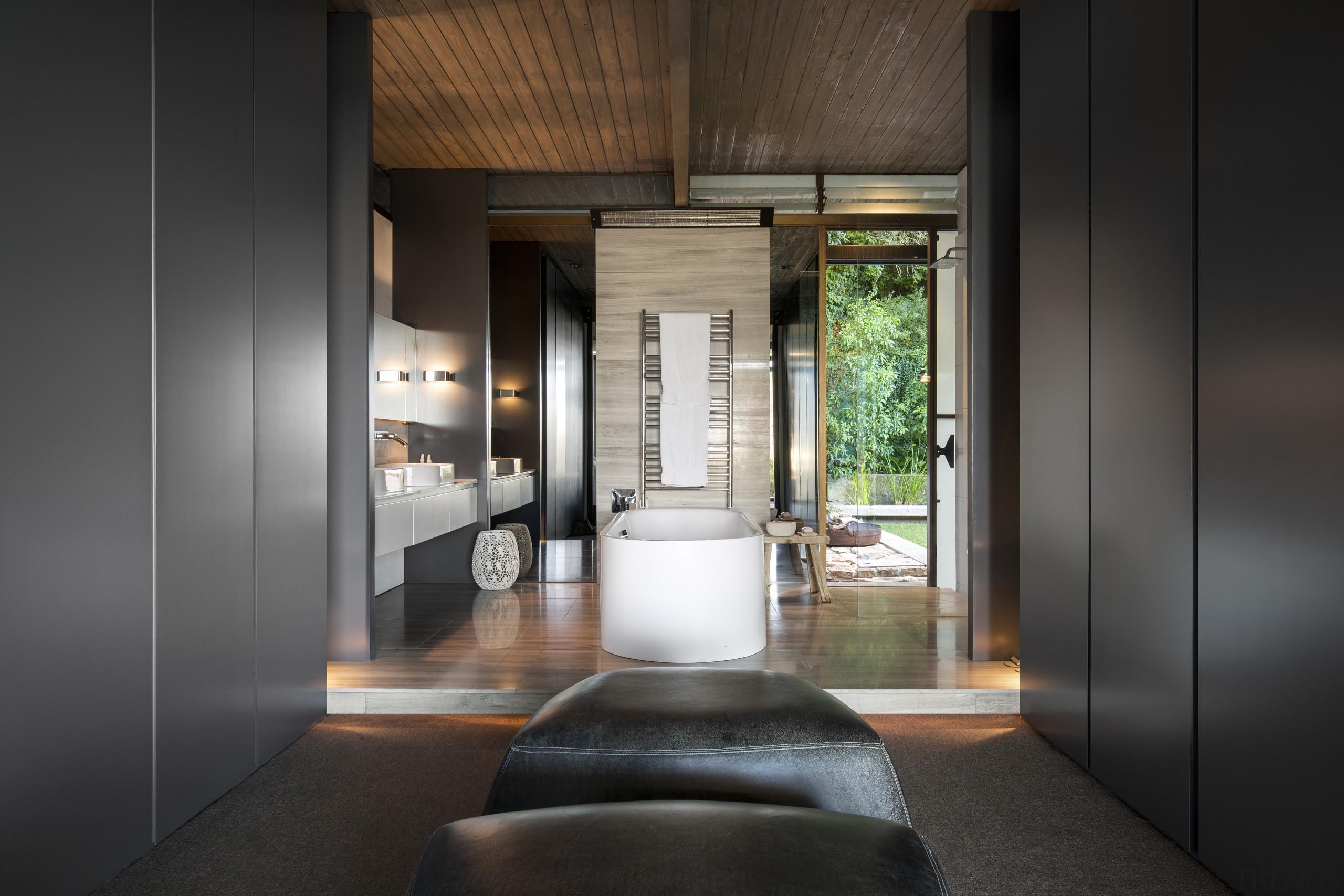 In this renovated master suite, the new bathroom architecture, interior design, black, gray