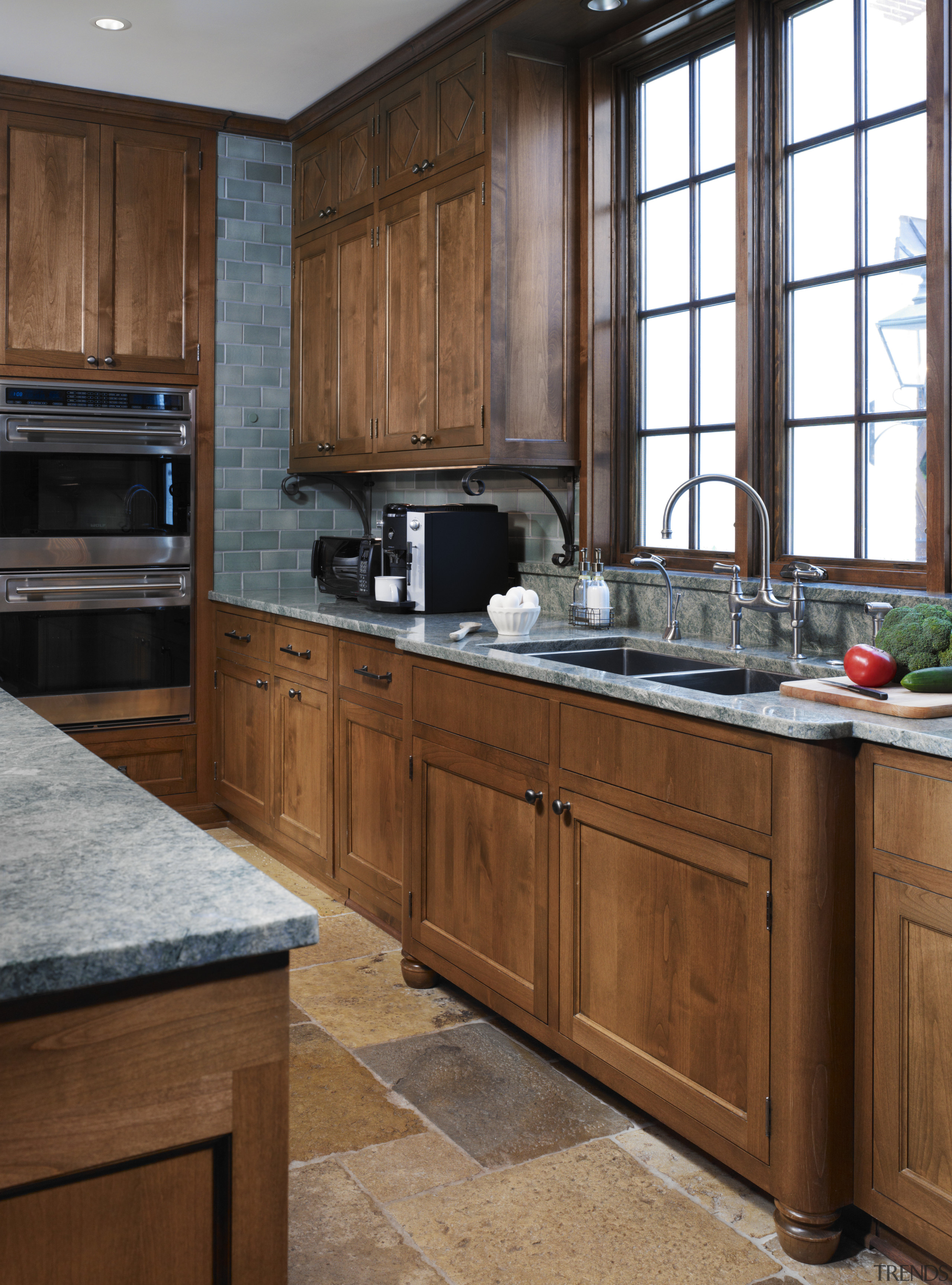 View of traditional kitchen with wooden cabinetry and cabinetry, countertop, cuisine classique, interior design, kitchen, room, brown