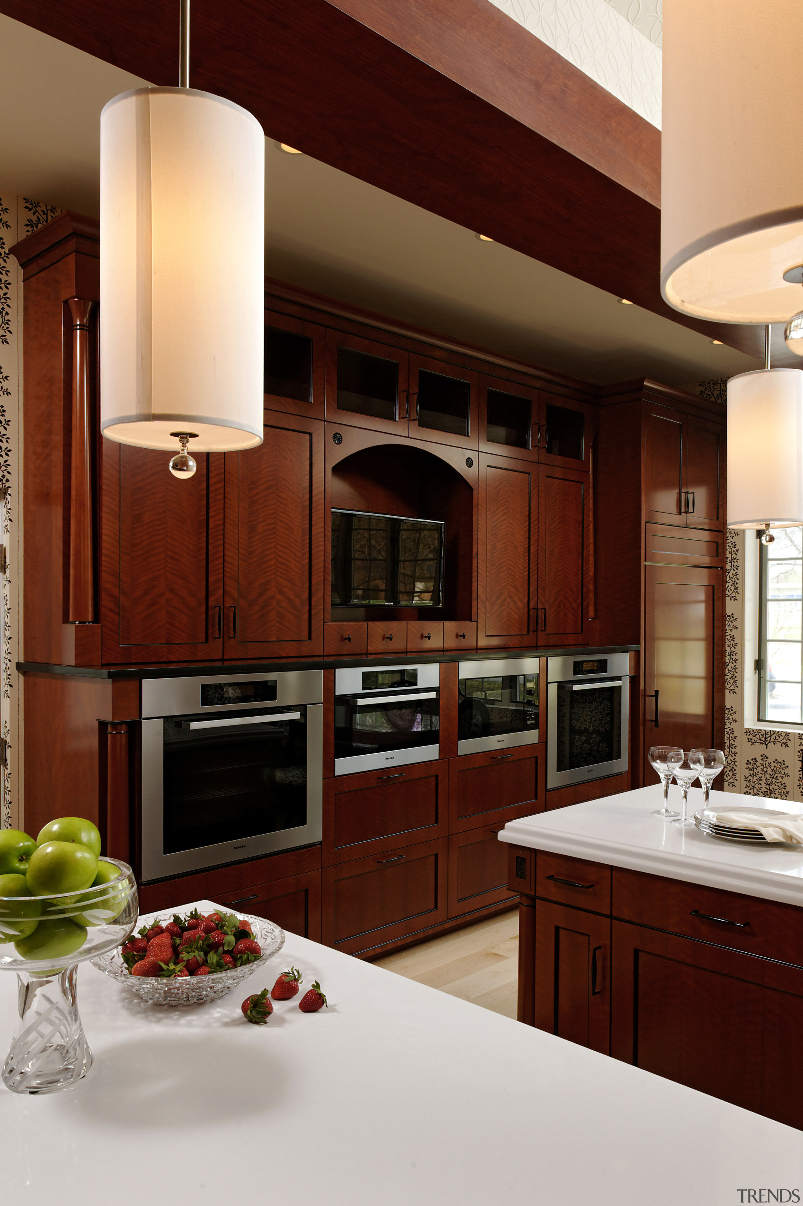 A wall of cabinetry contains aTV and several cabinetry, countertop, cuisine classique, home, interior design, kitchen, room, red