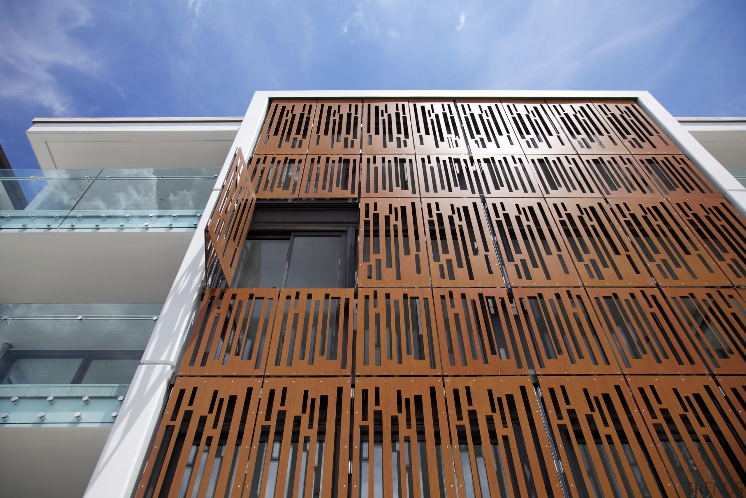 Laser-cut powdercoated aluminium screens on this apartment building architecture, building, commercial building, condominium, daylighting, facade, line, sky, structure, wood