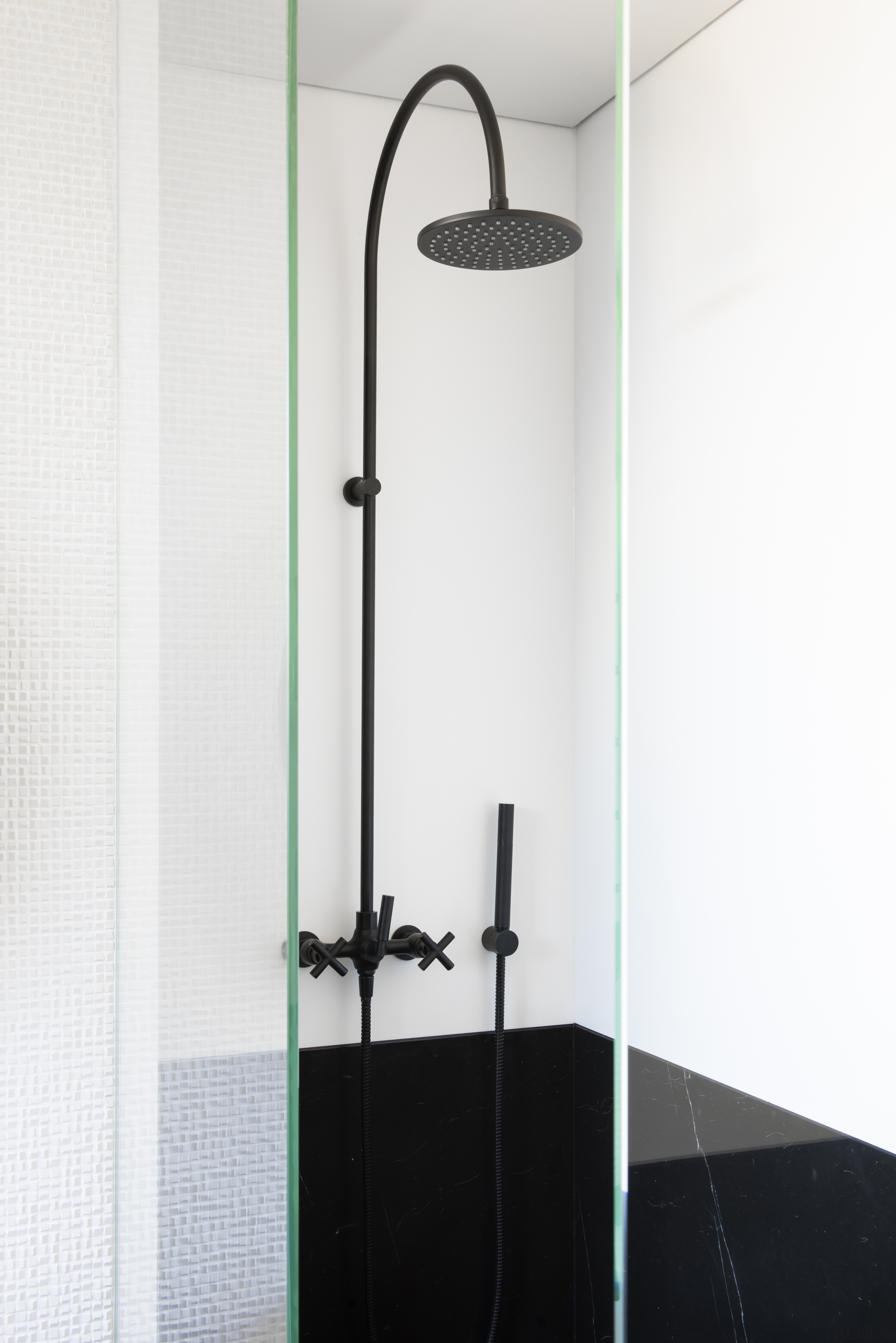 This contemporary bathroom's black and white theme continues architecture, bathroom, shower, shower panel, white, black fittings, Minosa, Darren Genner
