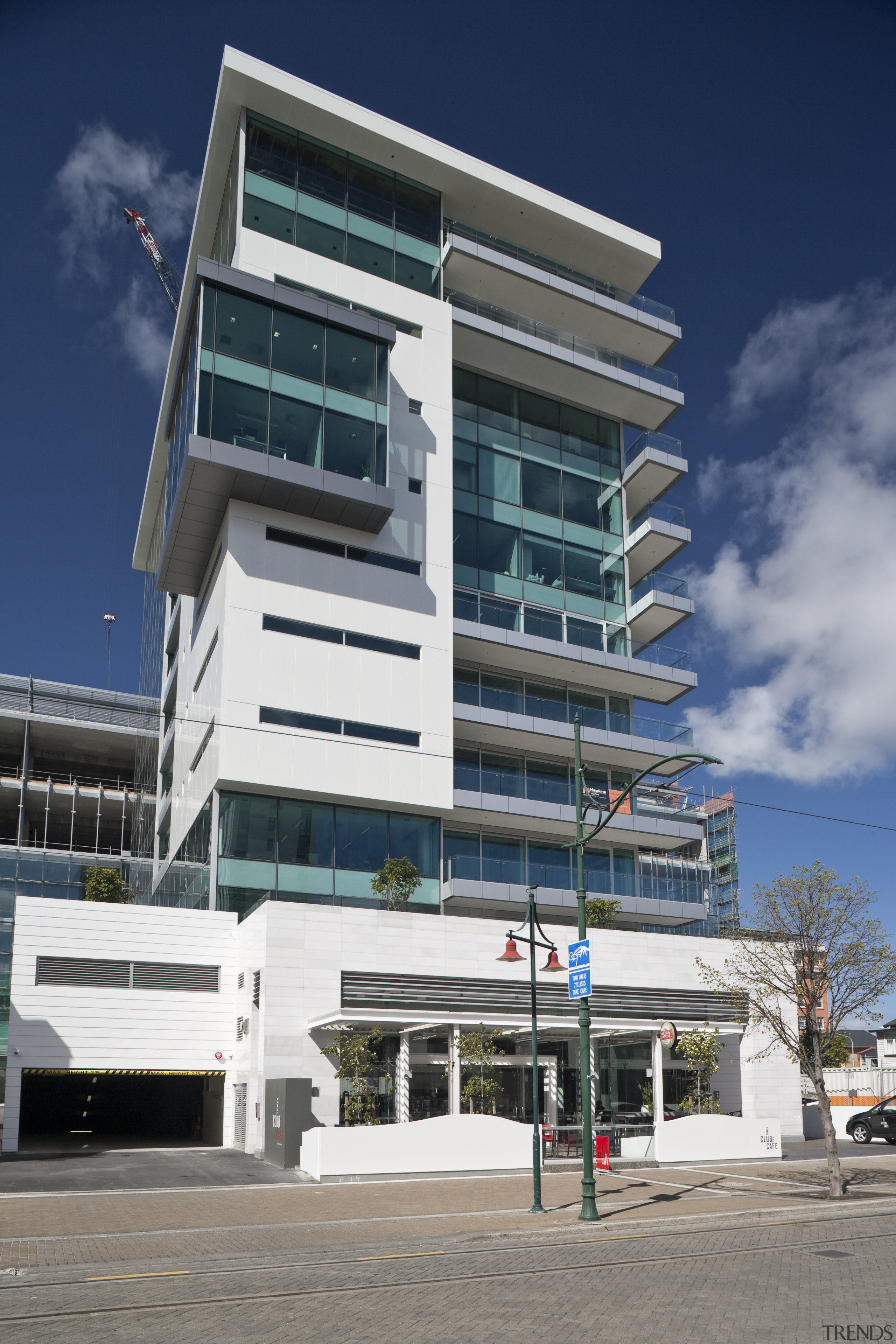 View of the Club Tower offices in Christchurch, apartment, architecture, building, commercial building, condominium, corporate headquarters, elevation, facade, headquarters, house, metropolitan area, mixed use, real estate, residential area, sky, gray, blue