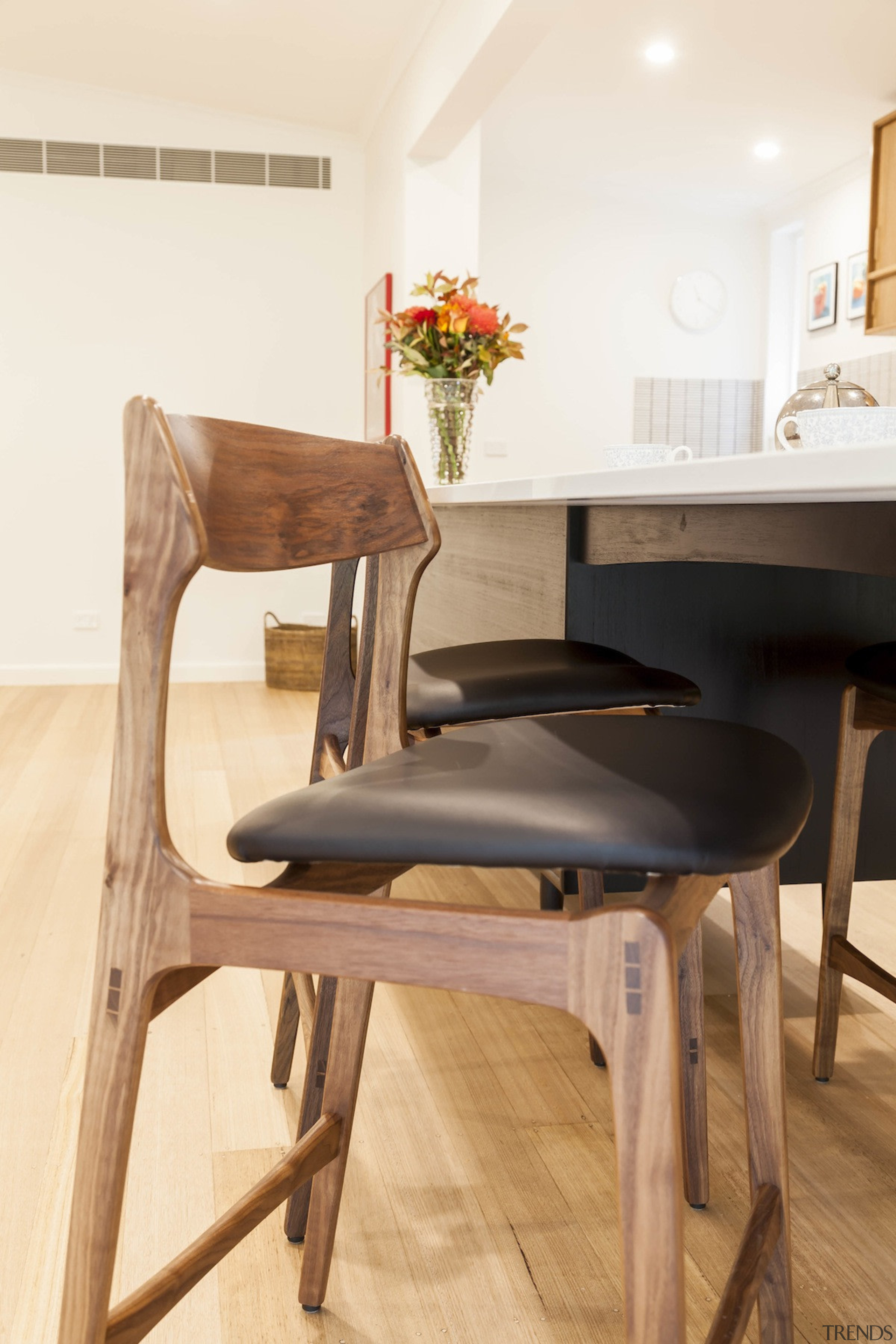 A closer view of the interior decoration - chair, dining room, floor, flooring, furniture, hardwood, product design, table, wood, white