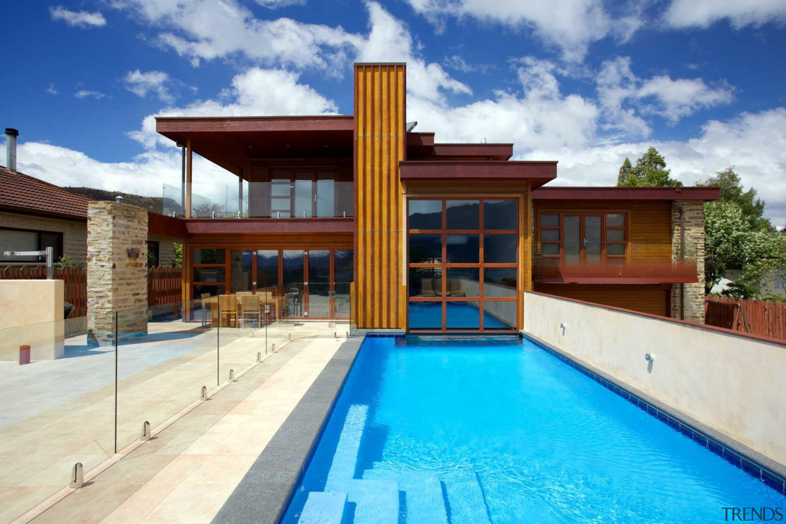 This pool by Mayfair Pools laps against the estate, facade, home, house, leisure, property, real estate, swimming pool, villa