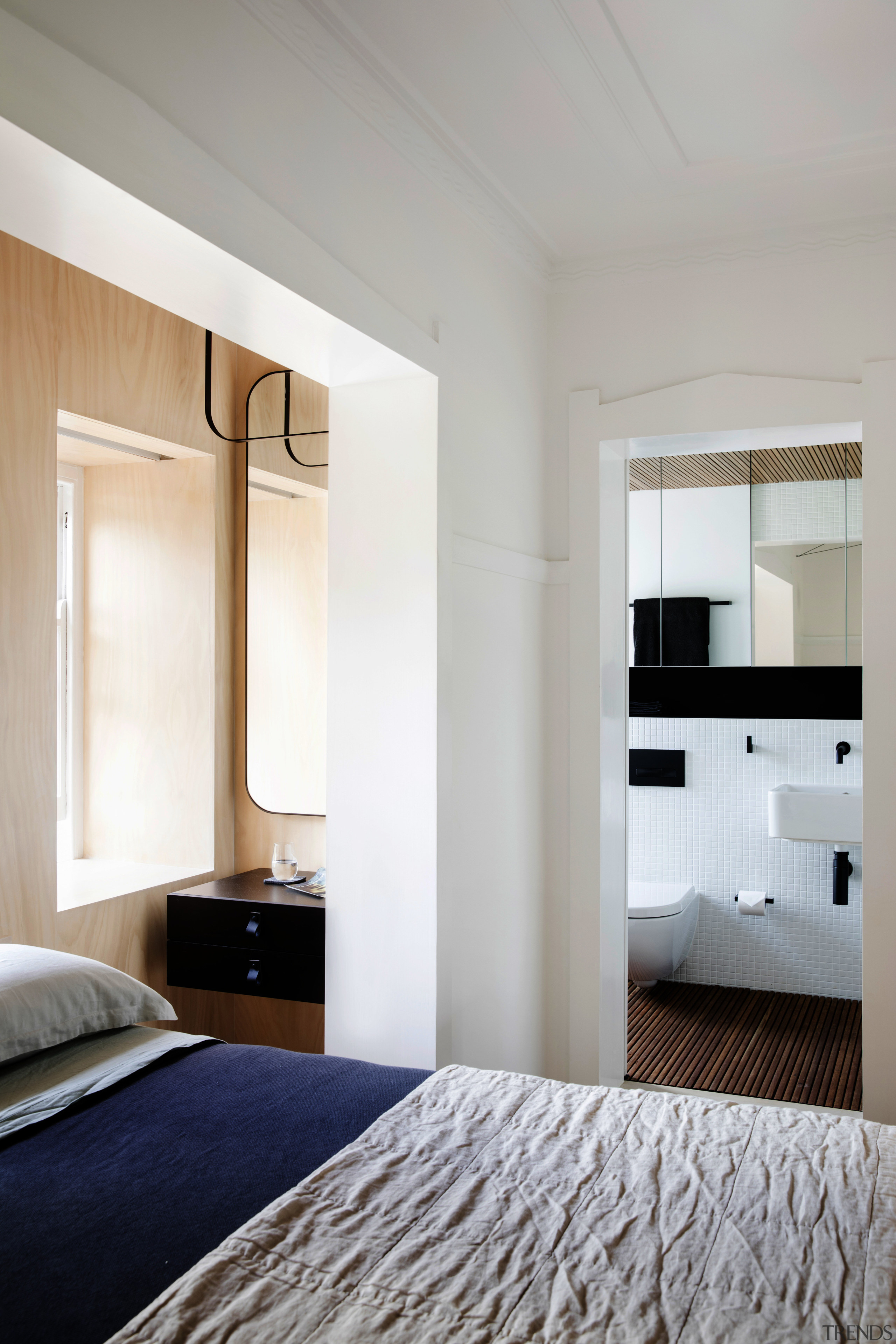 This reworked studio space by Architect Prineas vastly architecture, bed frame, bedroom, ceiling, floor, home, interior design, room, suite, wall, window, gray