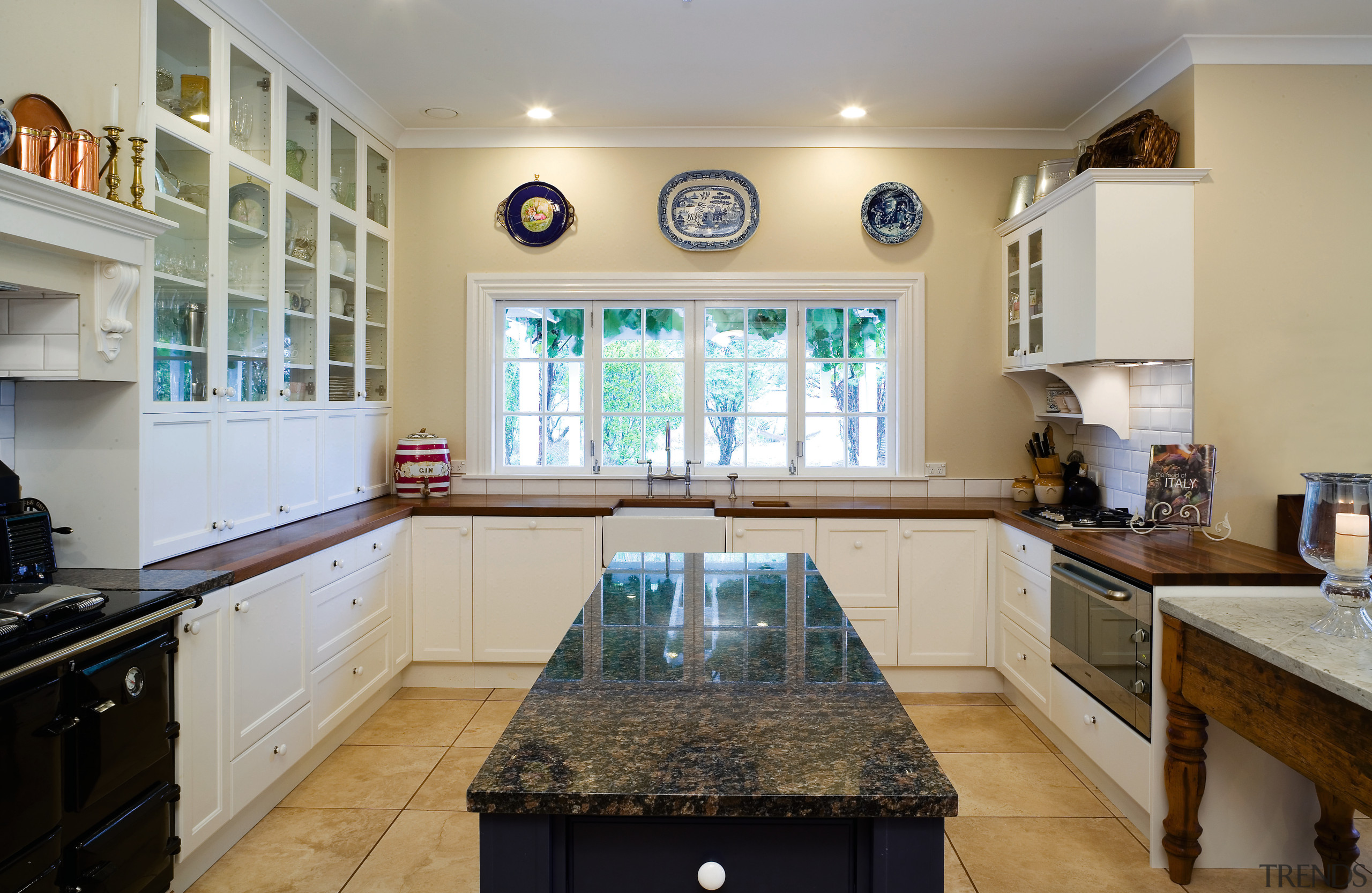 A view of this kitchen featuring tiled flooring, cabinetry, countertop, estate, home, interior design, kitchen, property, real estate, room, window, gray