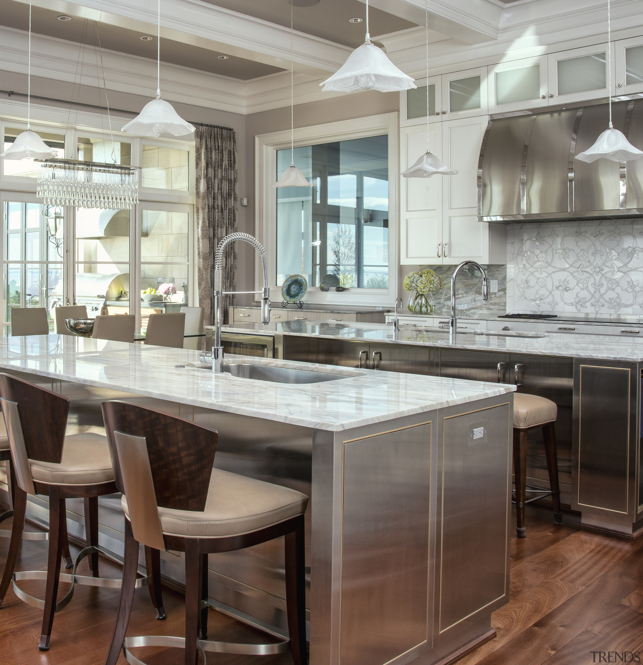 Slender marble countertops add a contemporary accent to cabinetry, countertop, cuisine classique, flooring, furniture, hardwood, interior design, kitchen, table, wood flooring, gray, brown