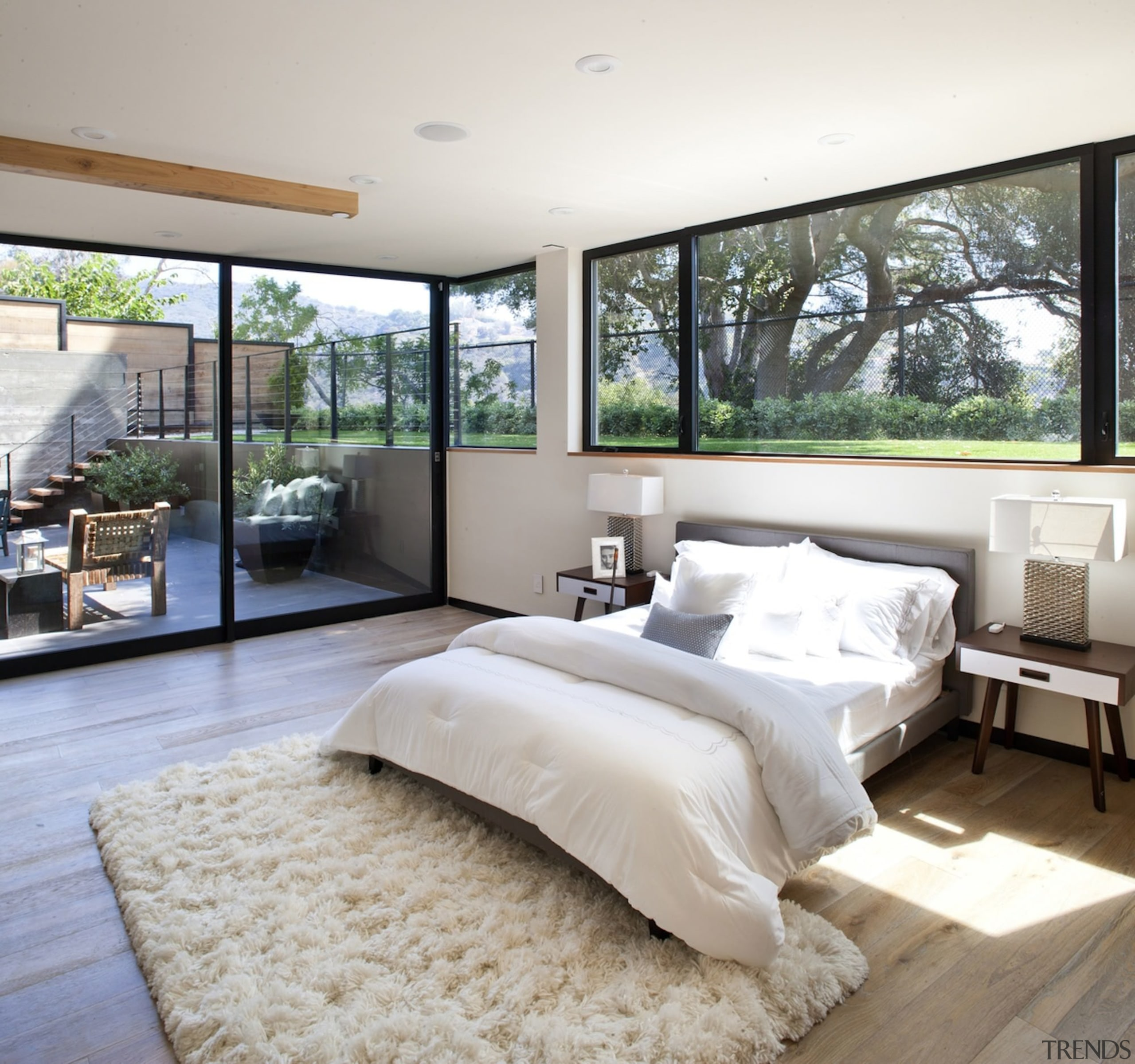 A sunken bedroom with views out to the bed frame, bedroom, ceiling, floor, home, interior design, mattress, wall, window, wood, gray
