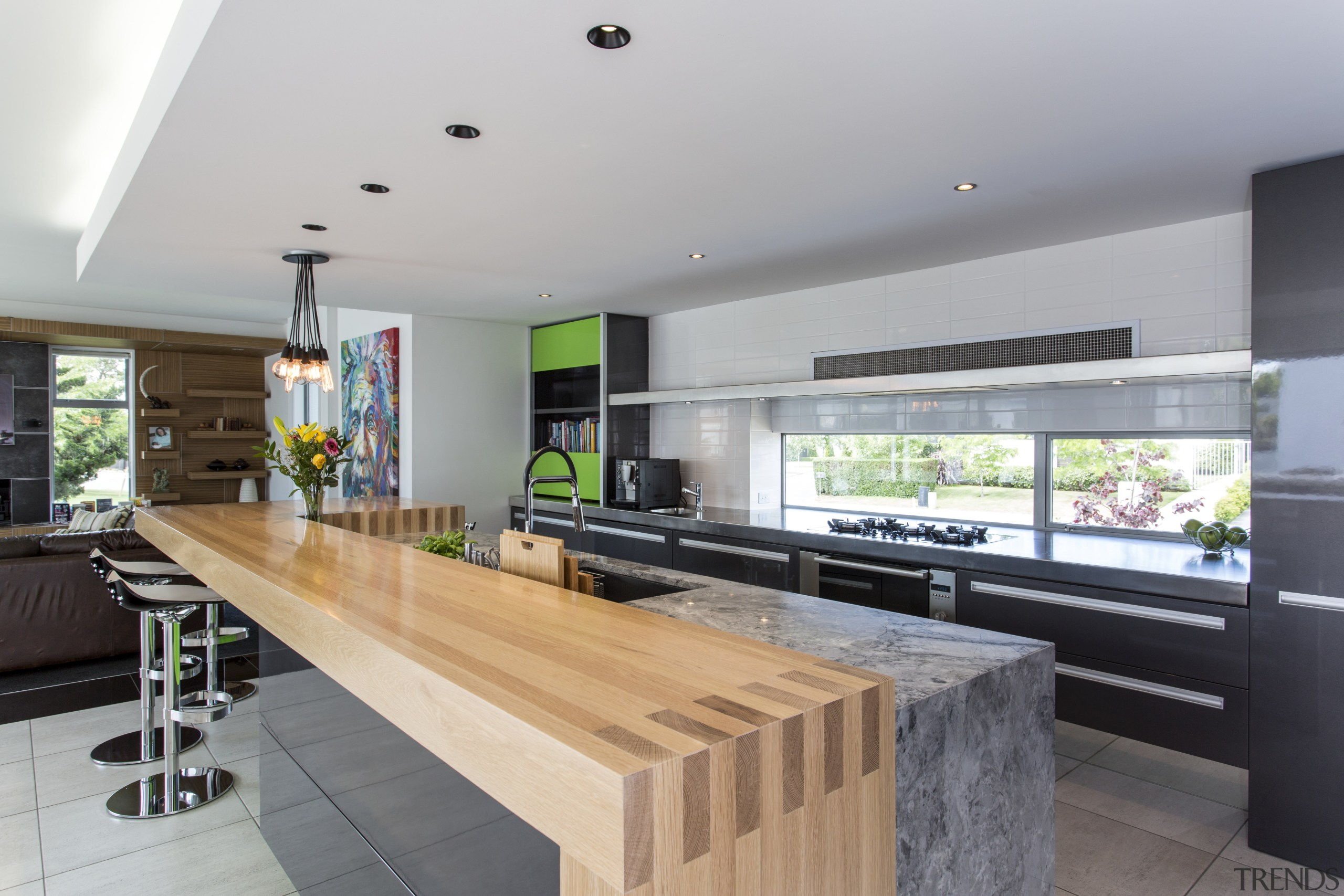 This crisp, geometric design caters to the owners countertop, house, interior design, kitchen, property, real estate, gray