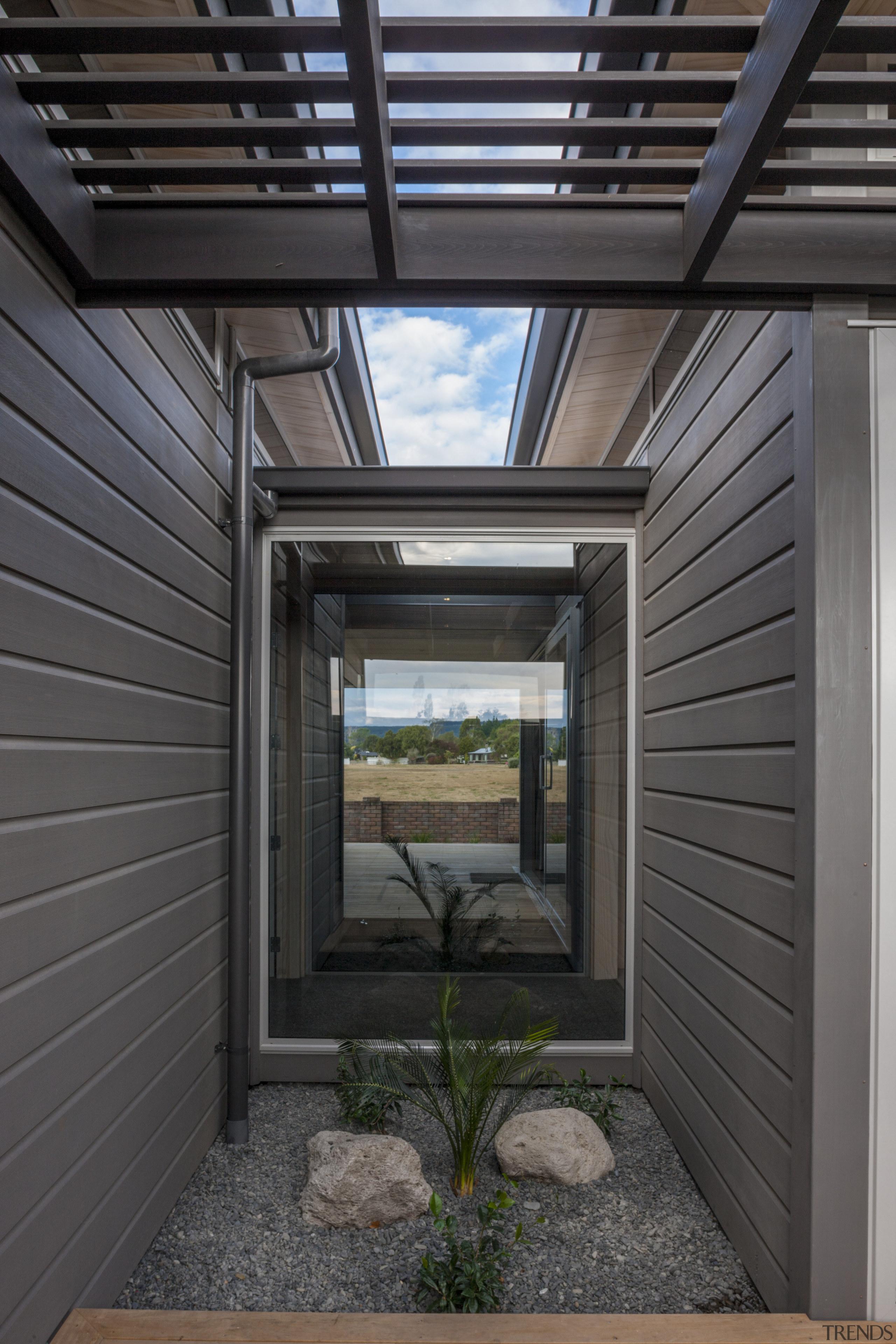 Lockwood Home built by Peter Richards - Lockwood daylighting, facade, home, house, siding, window, black, gray