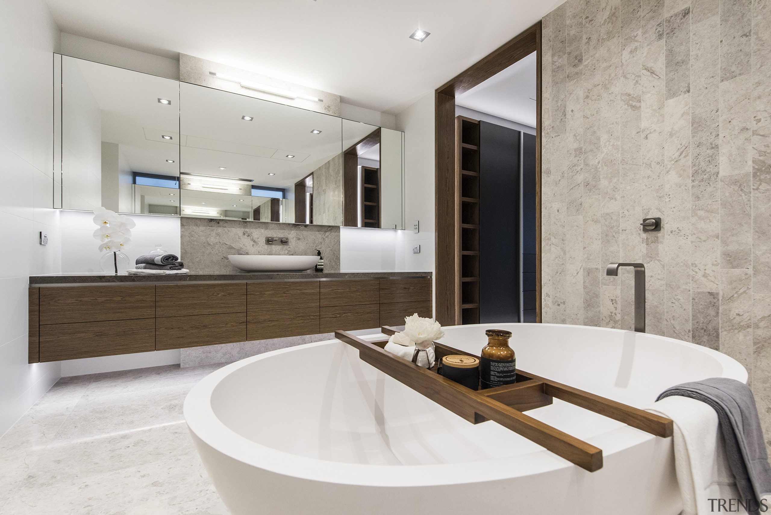 The feature wall behind the bathtub in this architecture, bathroom, interior design, property, real estate, room, sink, tap, gray