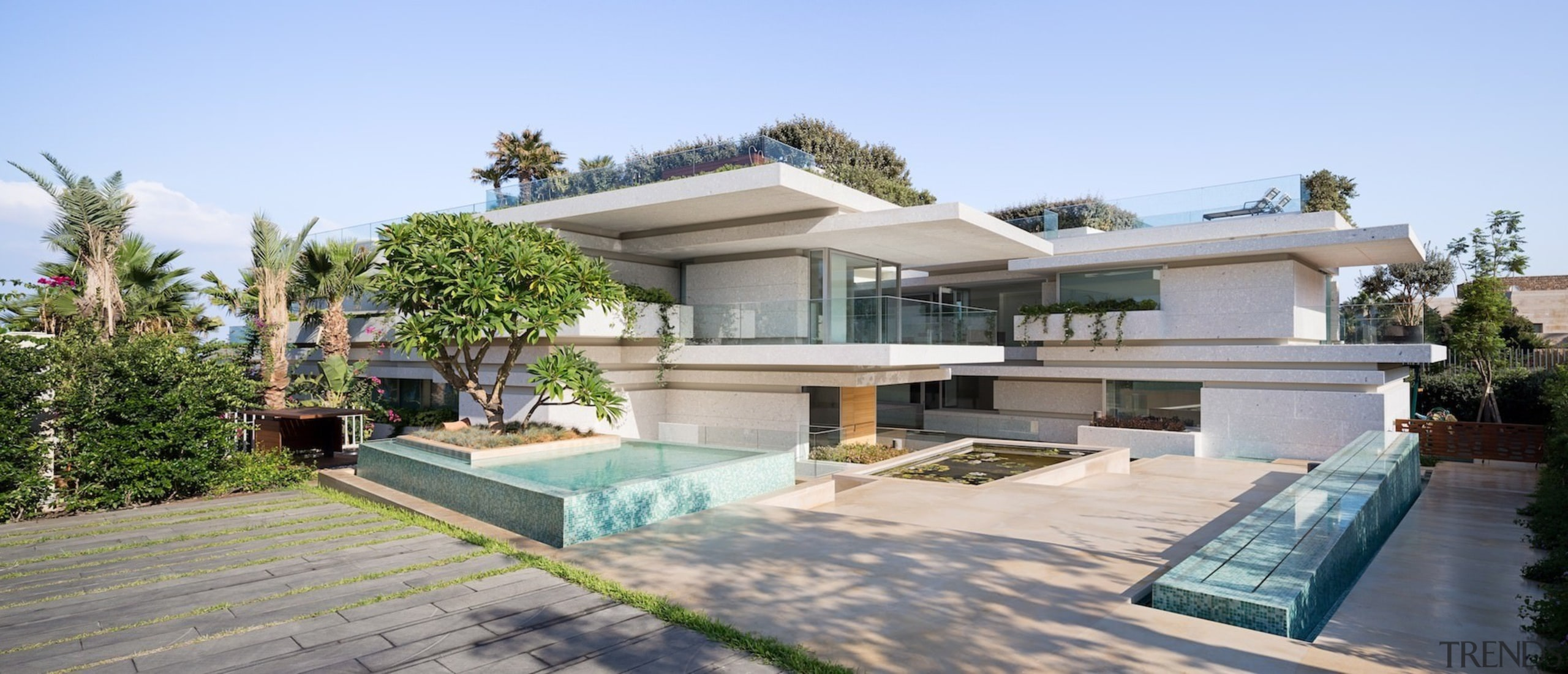 The home features multiple concrete layers, one stacked apartment, elevation, estate, facade, home, house, mansion, official residence, property, real estate, residential area, swimming pool, villa, gray, teal