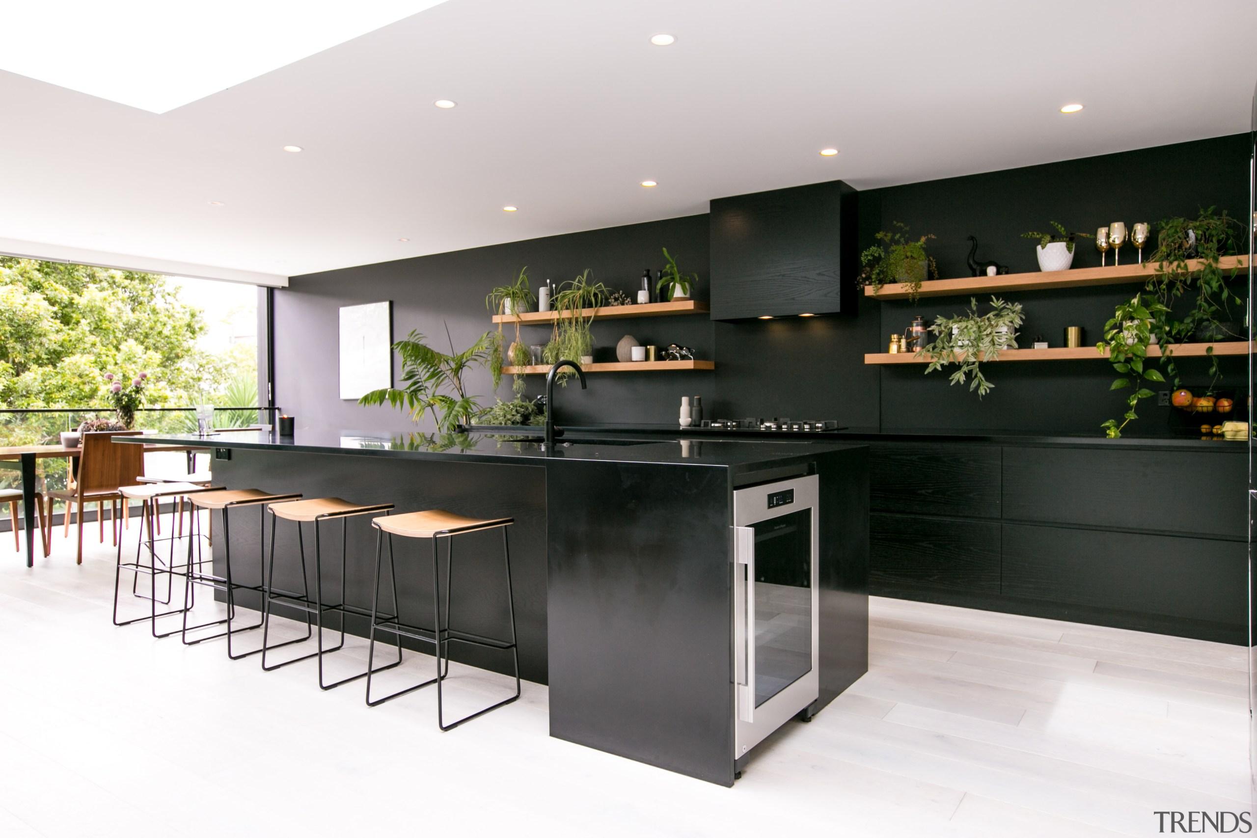 In this kitchen by architect Evelyn McNamara, Resene countertop, interior design, kitchen, white, black