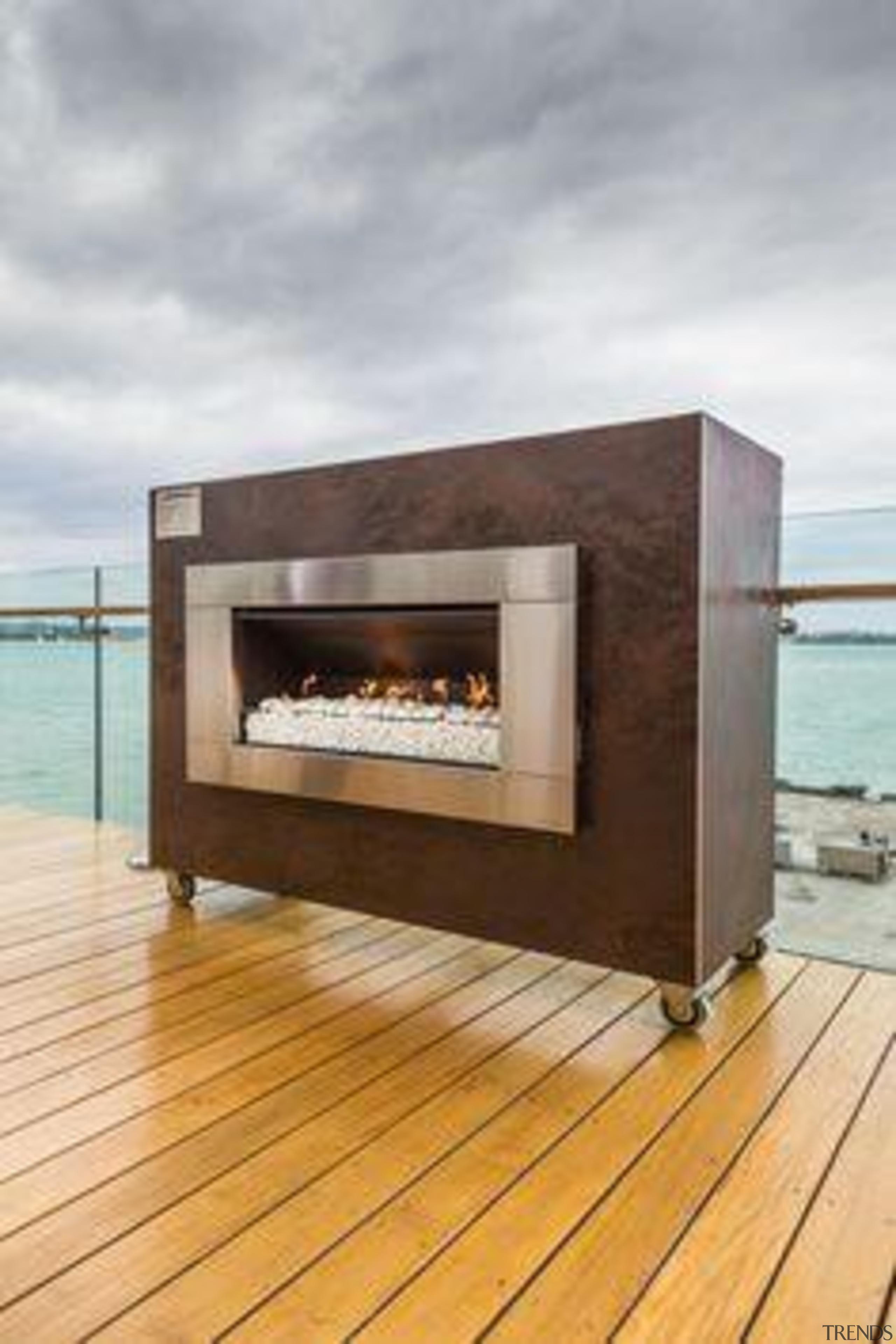 Escea fireplace, clad in Laminam Oxide Moro. - fireplace, gray, orange