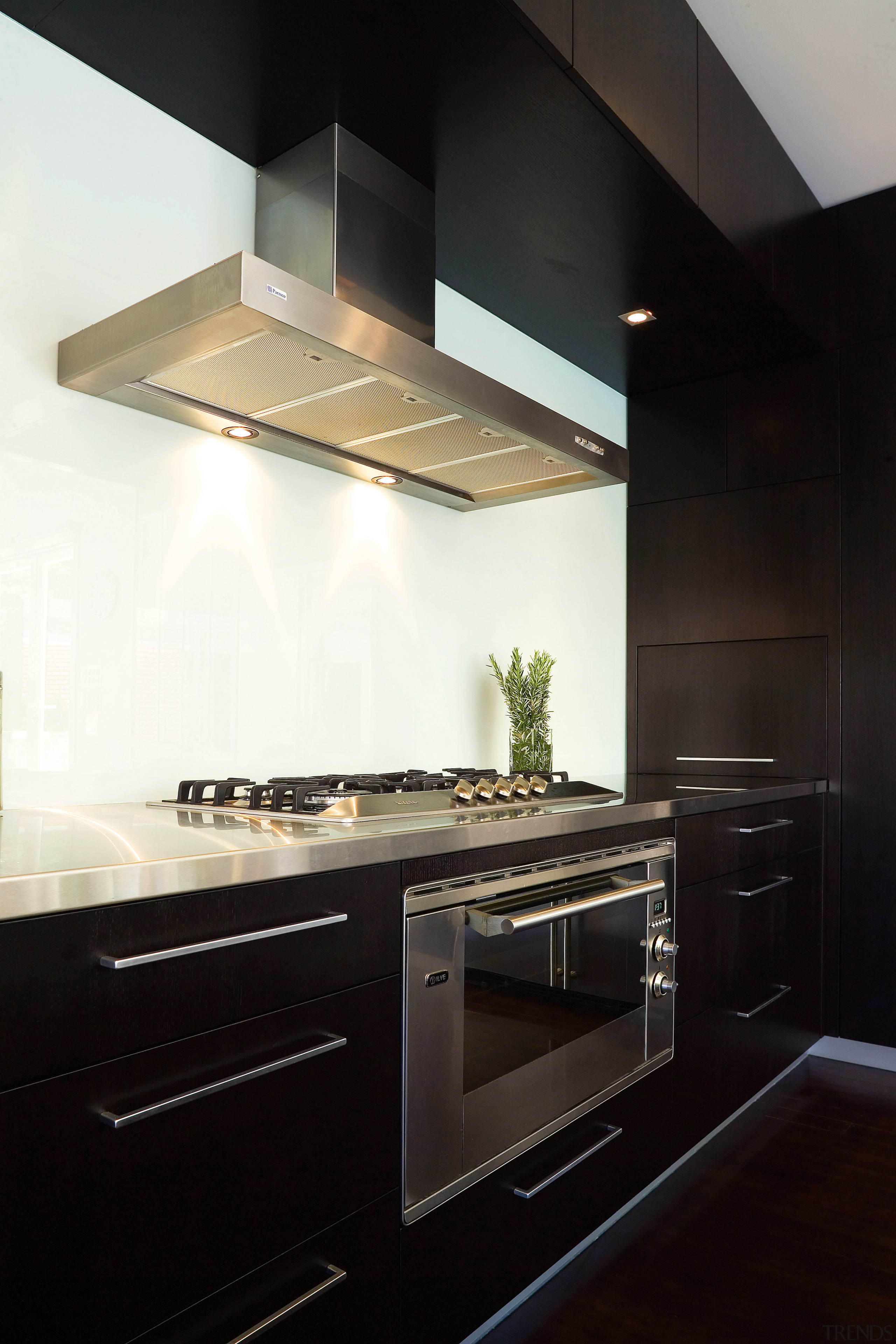 The kitchen has drawers instead of cupboards around cabinetry, countertop, cuisine classique, home appliance, interior design, kitchen, kitchen stove, under cabinet lighting, black, white