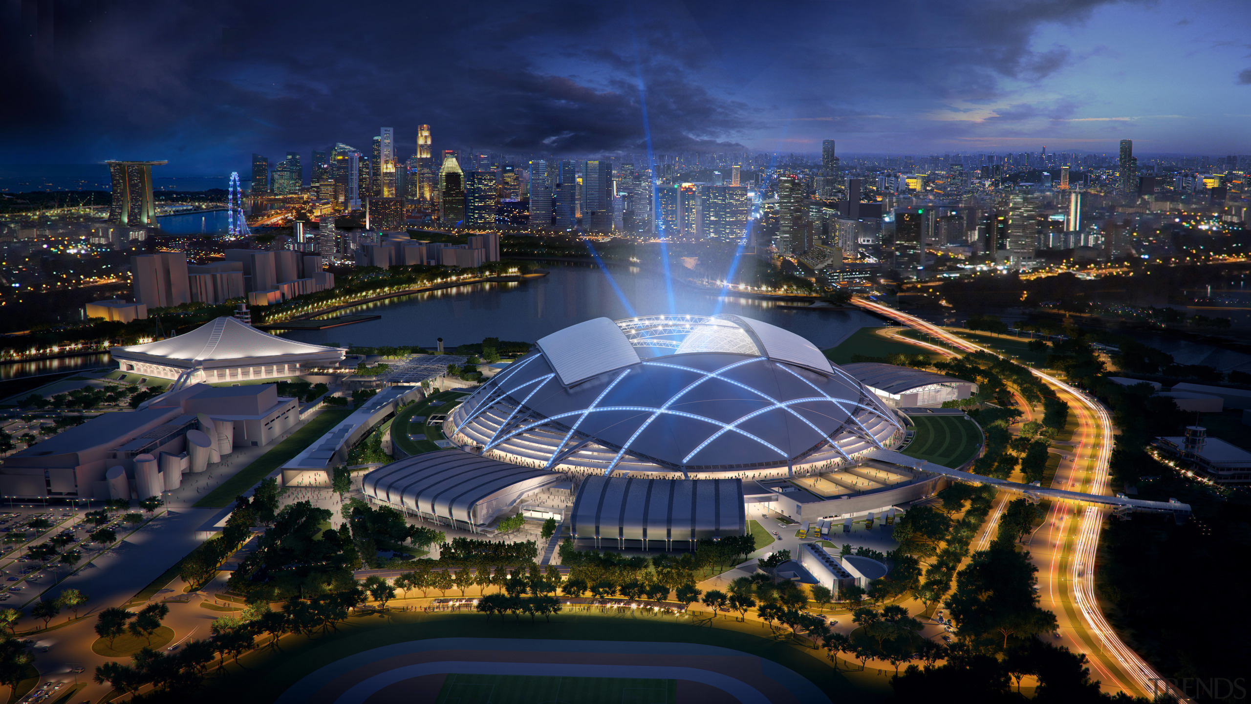 The new Singapore Sports Hub is a dramatic aerial photography, bird's eye view, city, cityscape, downtown, landmark, metropolis, metropolitan area, night, reflection, sky, skyline, sport venue, structure, tourist attraction, urban area, urban design, water, water feature, water resources, blue, black