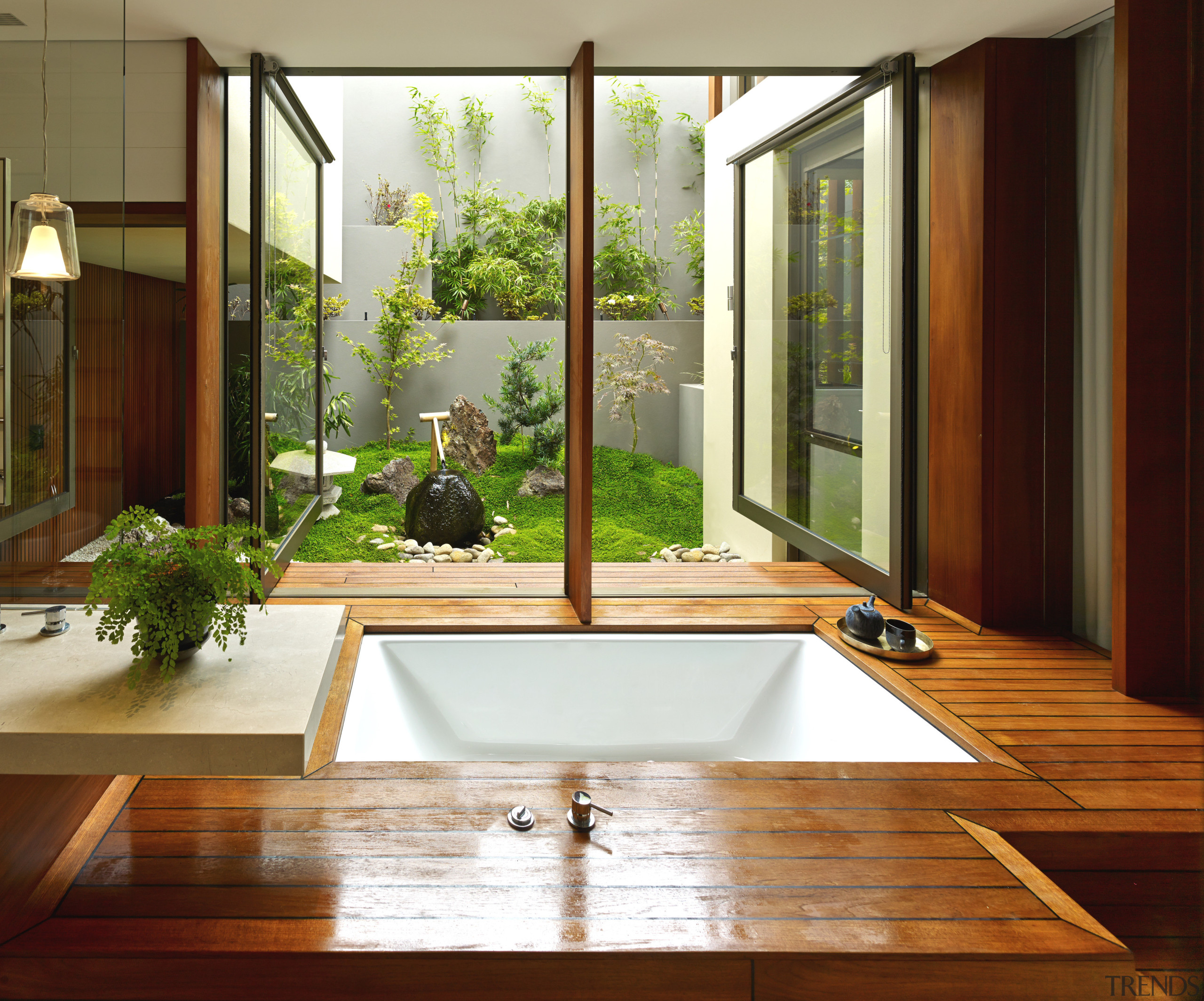 Pivoting windows over this tub open out to architecture, floor, home, house, interior design, window, wood, brown, white