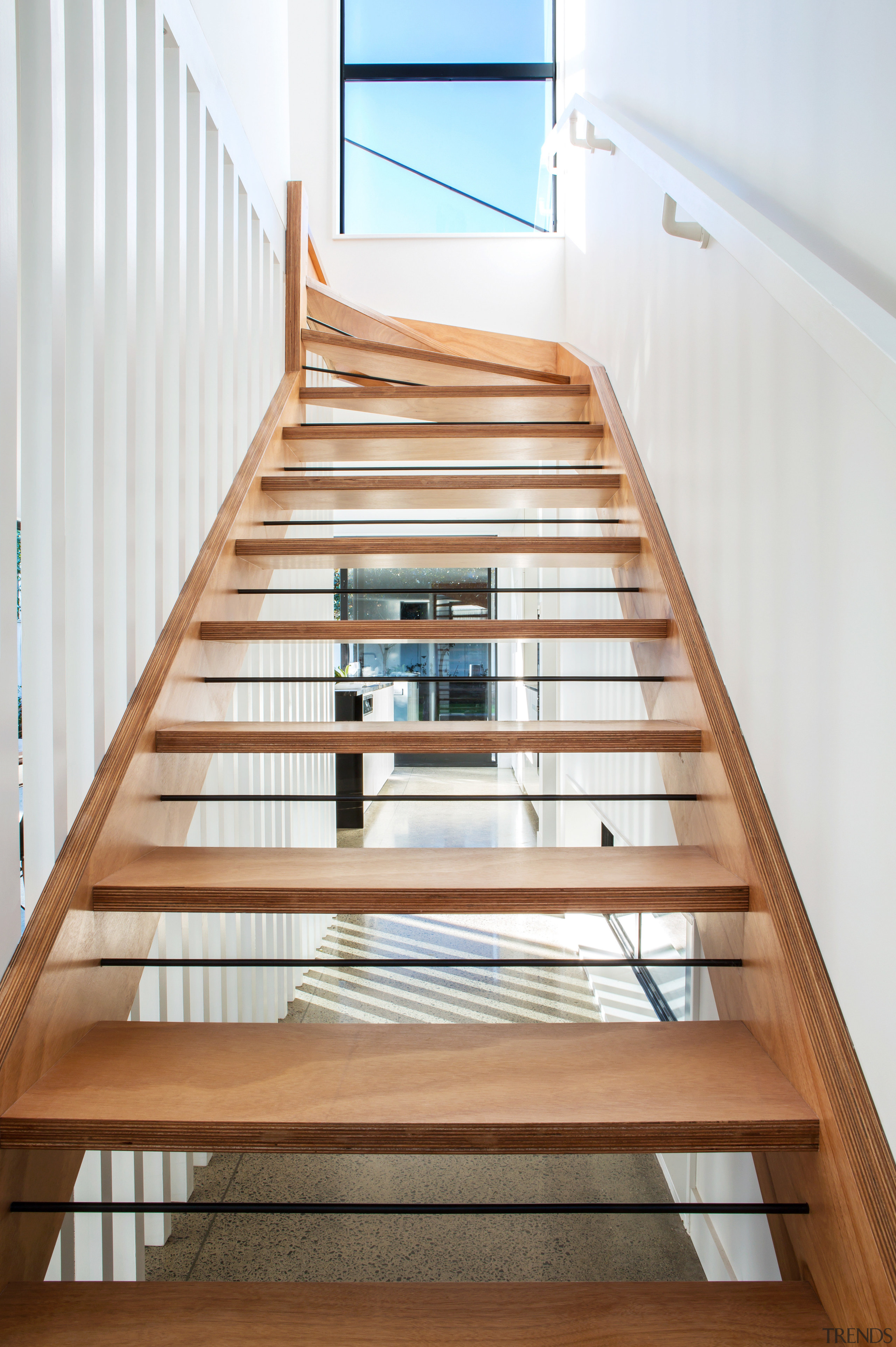 Wire inserts between the open treads on this apartment, architecture, daylighting, floor, glass, handrail, stairs, wood, white