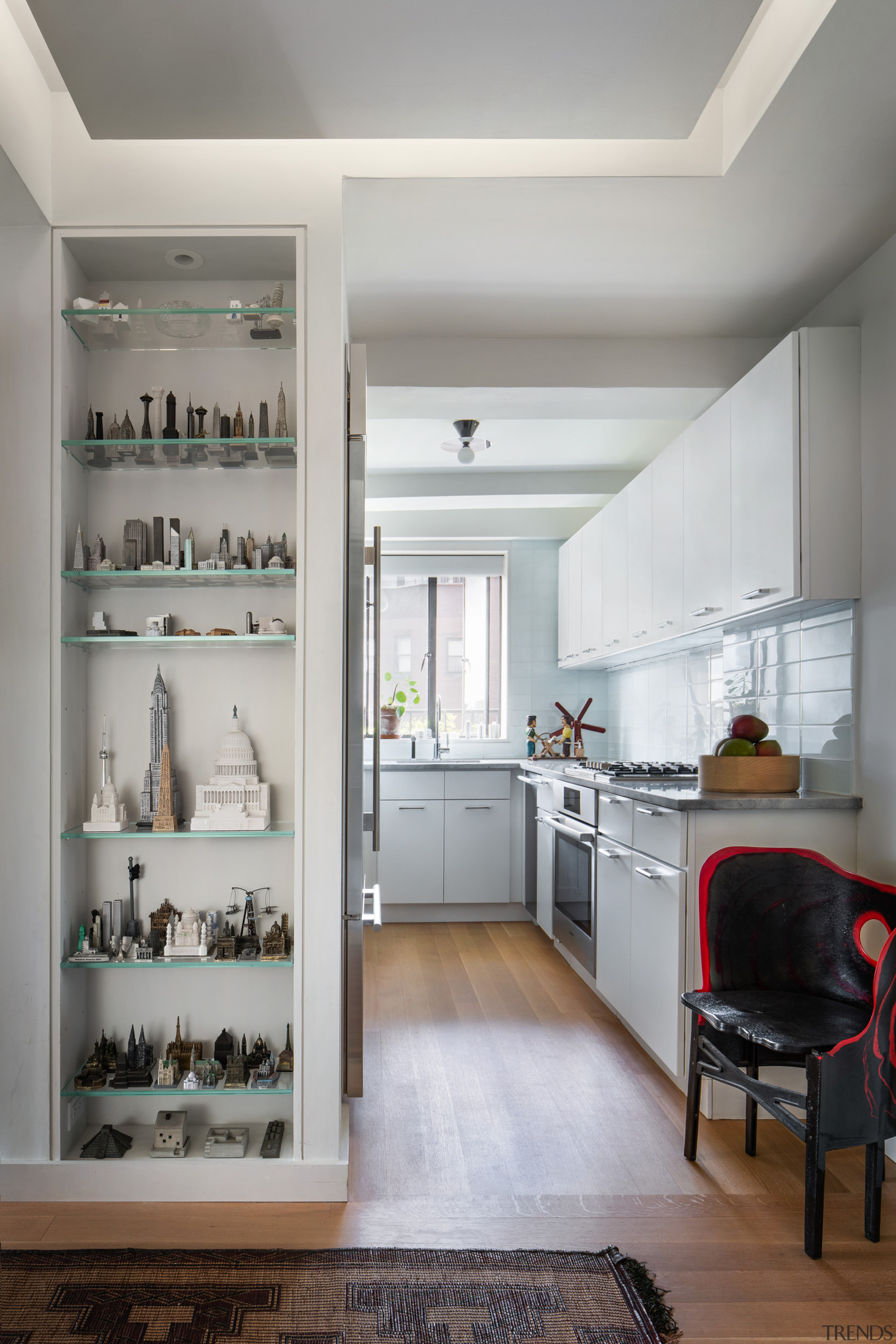 Just outside the kitchen, shelving displays architectural models