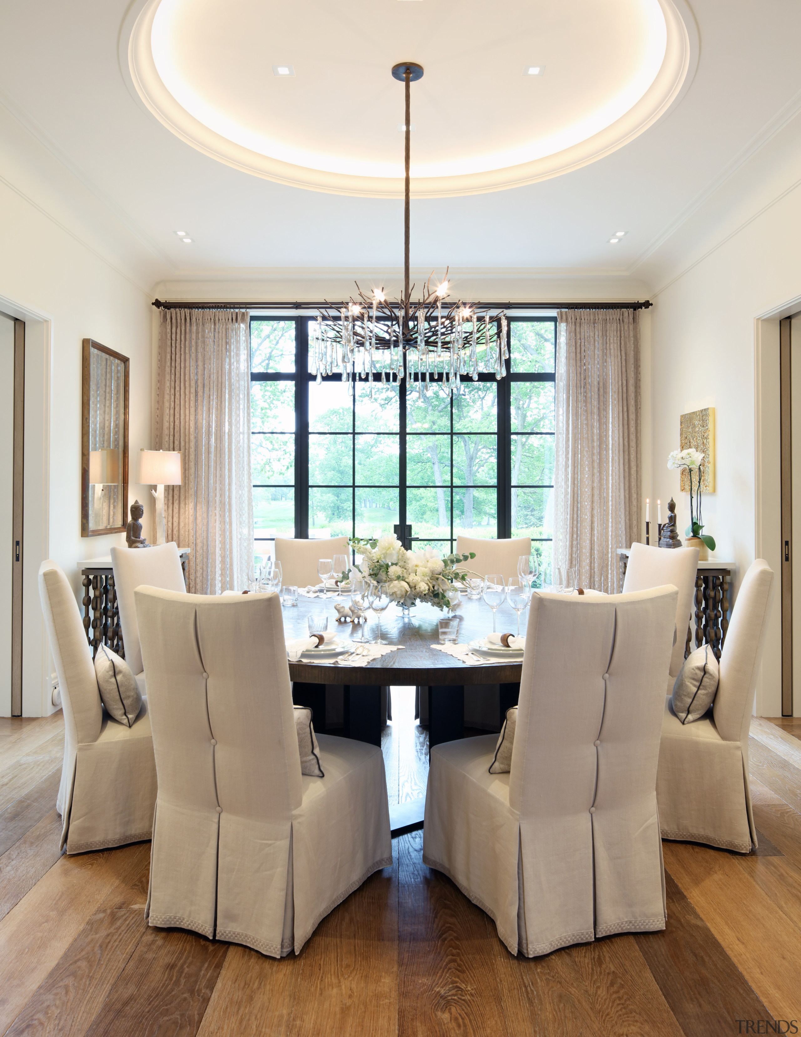 A feature ceiling and contemporary chandelier set off