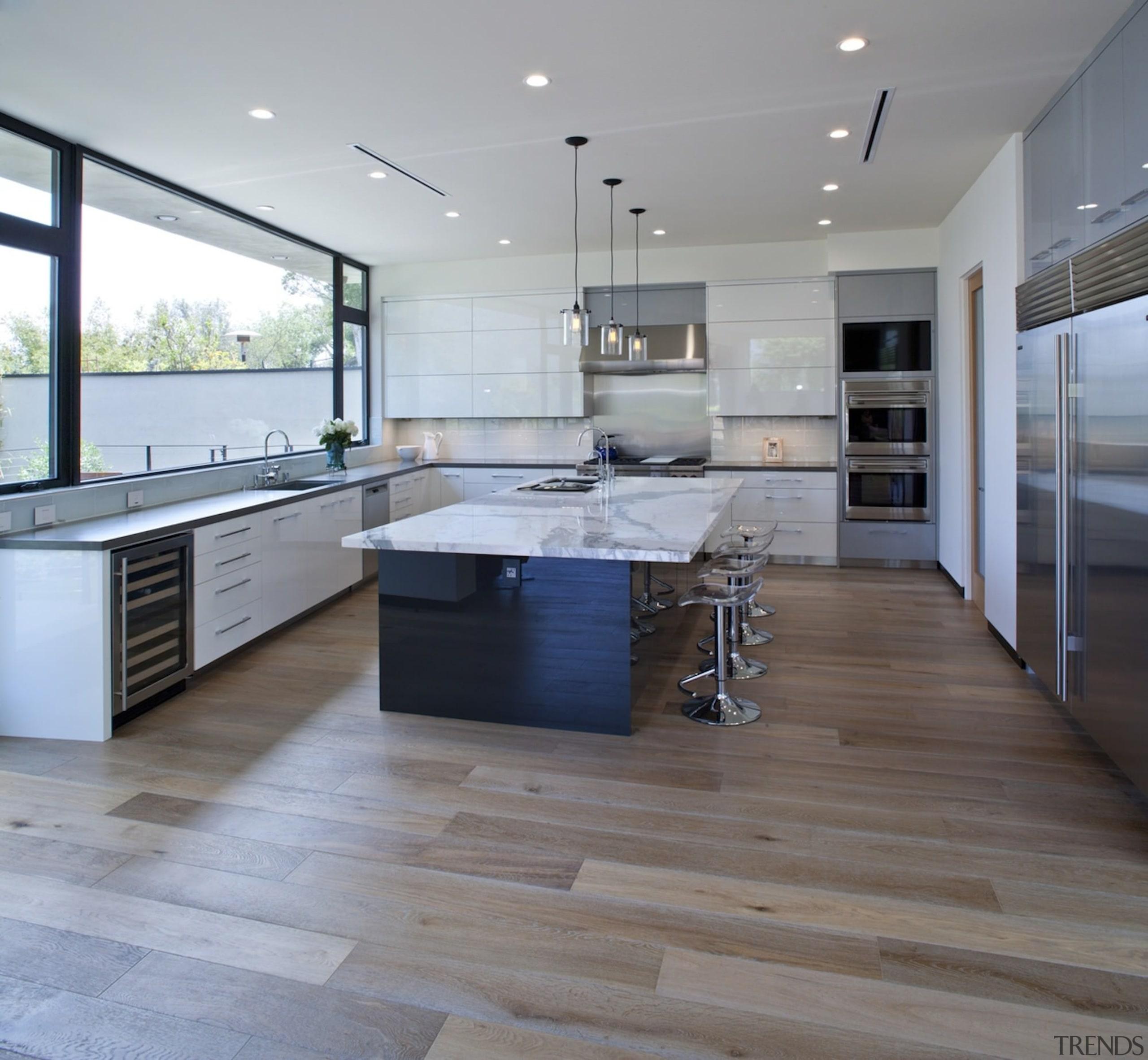 The spacious kitchen keeps the island close - countertop, floor, flooring, hardwood, interior design, kitchen, laminate flooring, real estate, tile, wood, wood flooring, gray