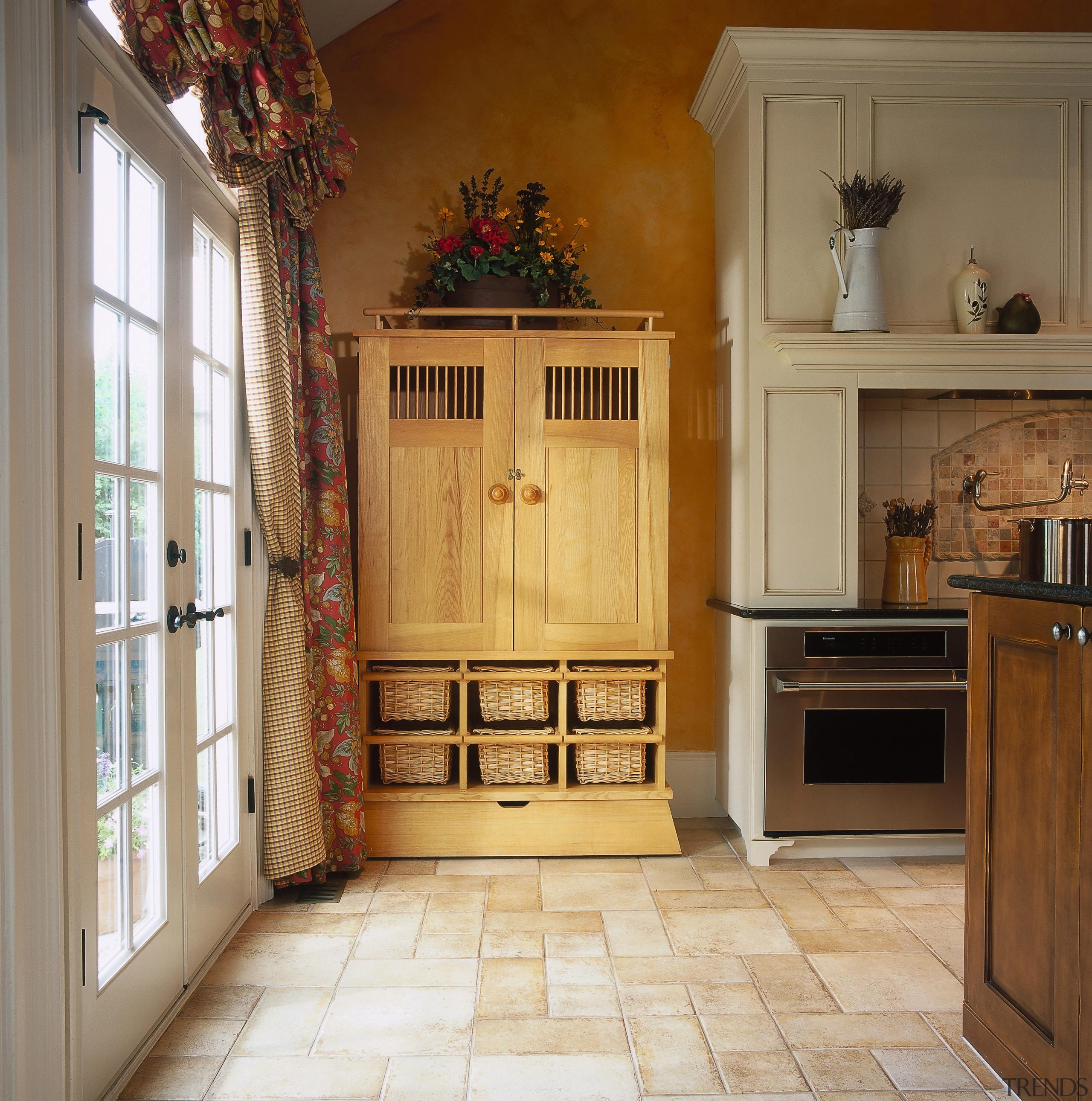 View of the storage unit within this kitchen cabinetry, countertop, door, floor, flooring, furniture, hardwood, home, interior design, kitchen, room, window, brown
